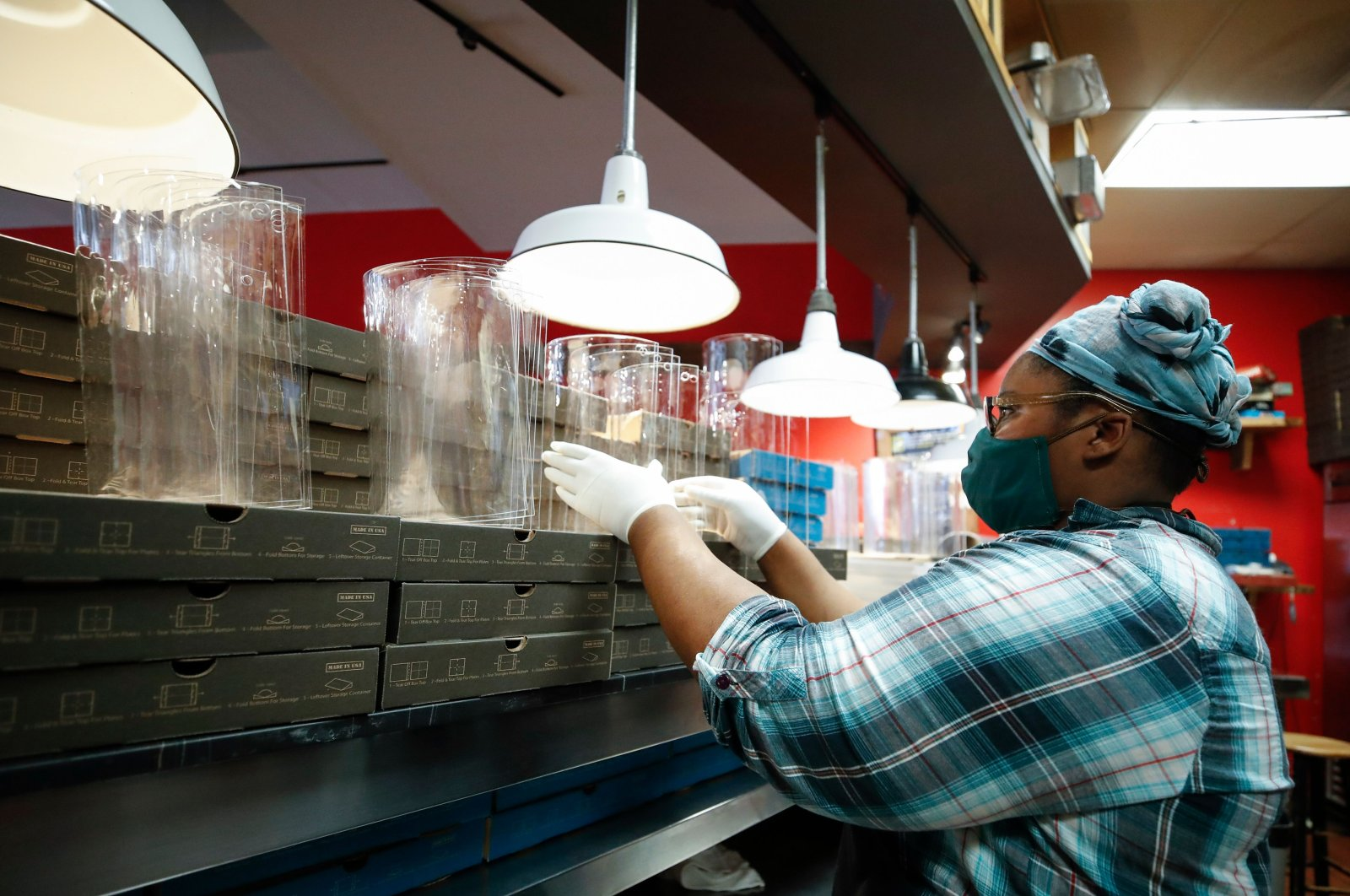 An employee makes acrylic face shields for front line responders at Dimo's Pizza in Chicago, Illinois, April 16, 2020. (AFP Photo)