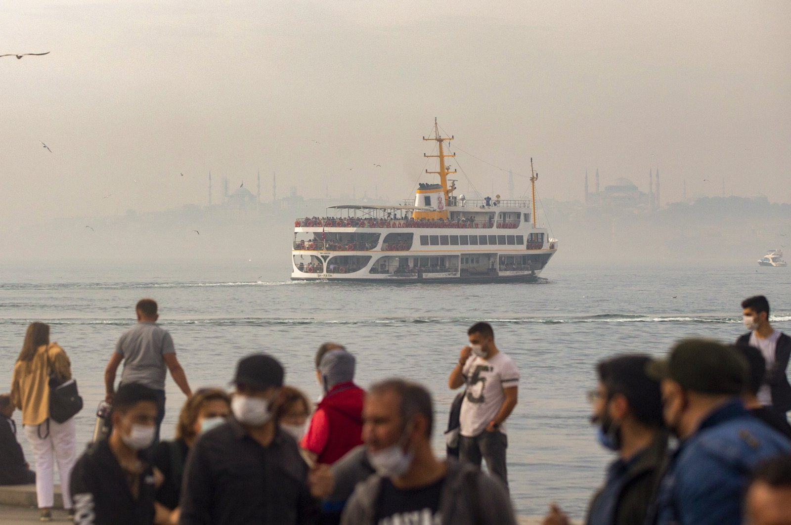 A ferry sails on the Bosphorus in front of the Hagia Sophia Grand Mosque and the Blue Mosque on a foggy day in Istanbul, Turkey, Oct. 25, 2020. (EPA Photo)