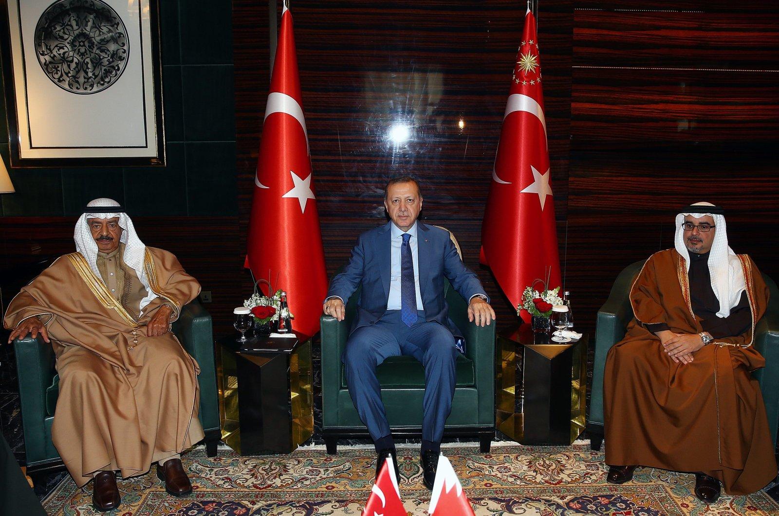 President Recep Tayyip Erdoğan (C) receives Bahrain's Prime Minister Khalifa bin Salman Al Khalifa (L) and Bahrain's Crown Prince Salman bin Hamad Al Khalifa during an official visit in Manama, Bahrain, Feb. 13, 2017. (AA Photo)