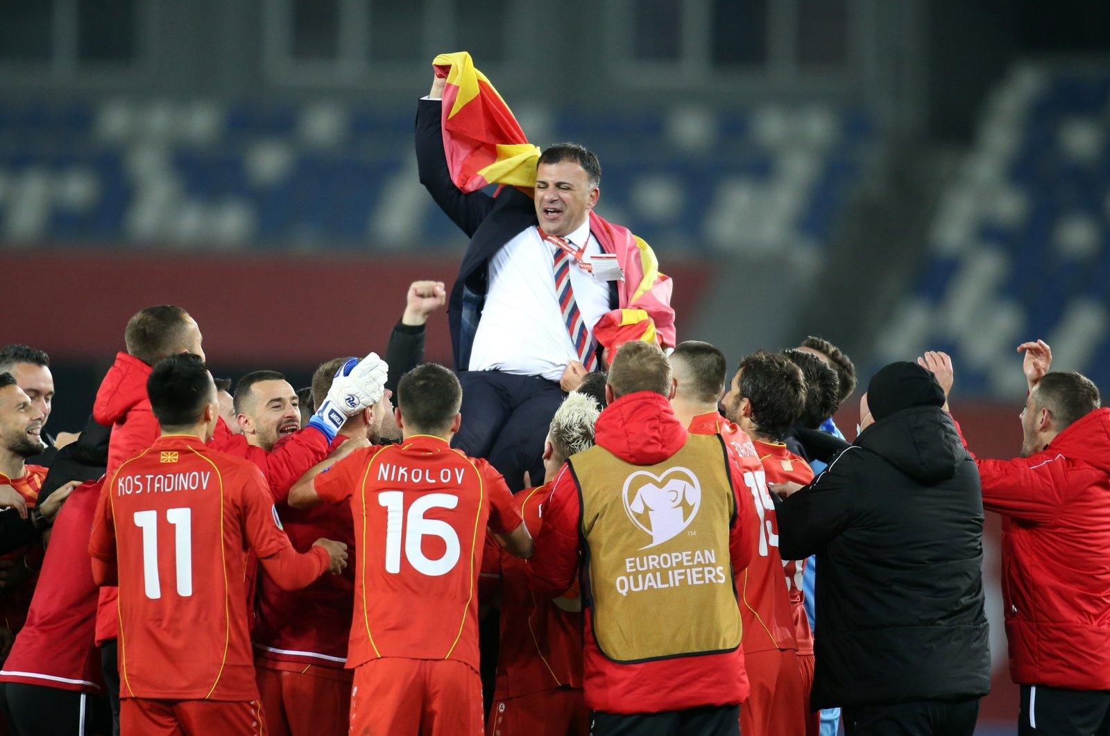 North Macedonia coach Igor Angelovski celebrates with players after the Euro 2020 Playoff Final match against Georgia at Boris Paichadze Dinamo Arena, Tbilisi, Georgia, Nov. 12, 2020. (Reuters Photo)