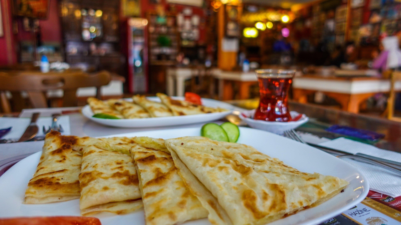 Potato gözleme with a side of Turkish tea at Gramofon Cafe. (Photo by Argun Konuk)