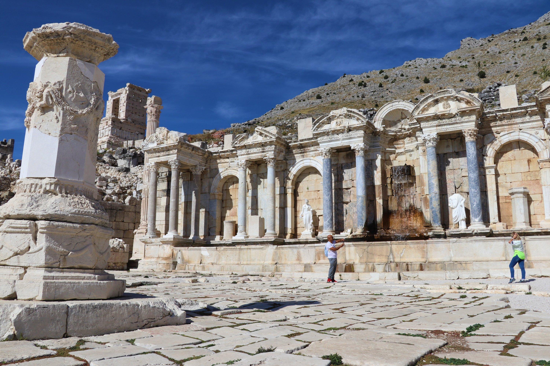 Visitors take photos at the ancient city of Sagalassos, Burdur province, southwestern Turkey, Nov. 12, 2020. (AA Photo)