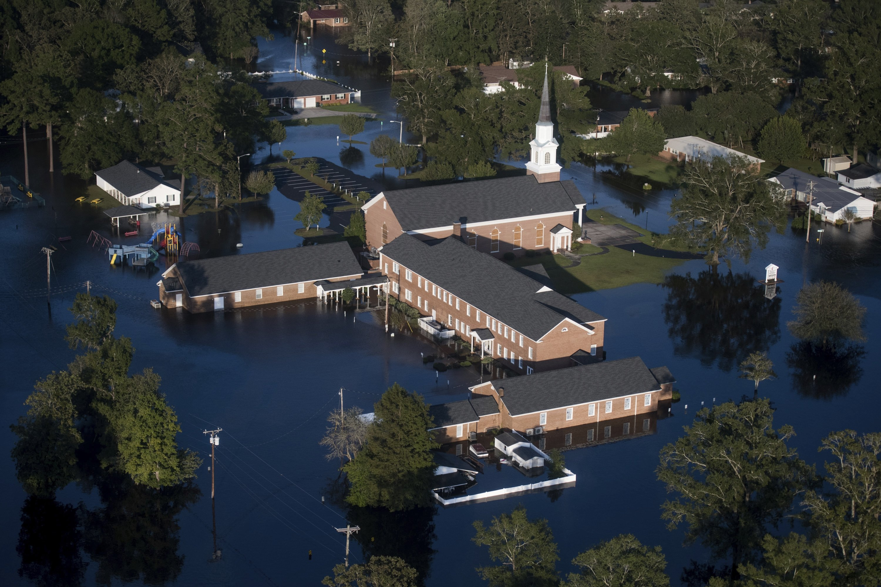 In this file photo, floodwaters surround a church and other buildings after Hurricane Florence struck the Carolinas, Conway, South Carolina, U.S., Sept. 17, 2018. (AP Photo)