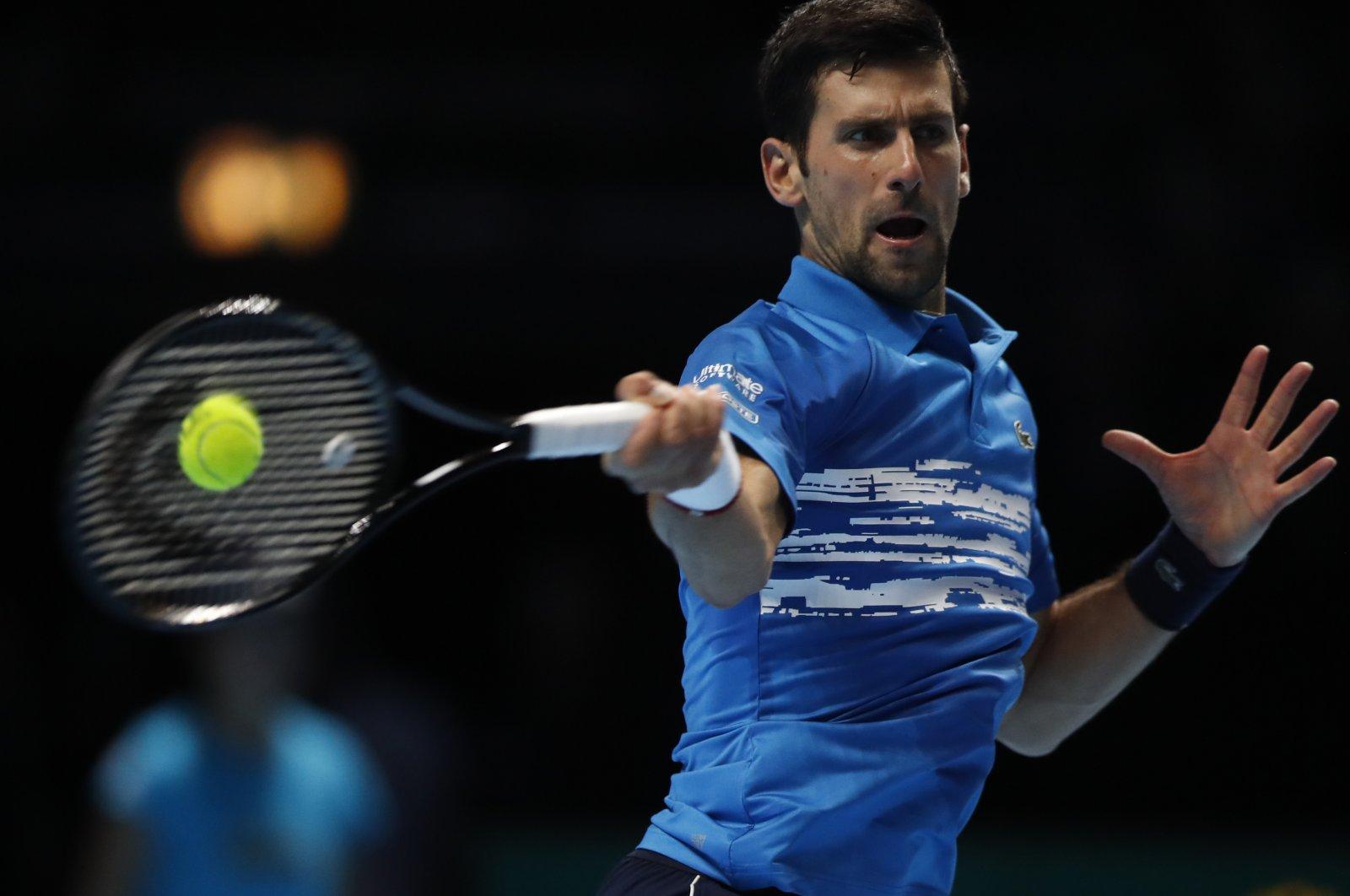 Novak Djokovic plays a return to Matteo Berrettini during an ATP Finals match in London, Britain, Nov. 10, 2019. (AP Photo)