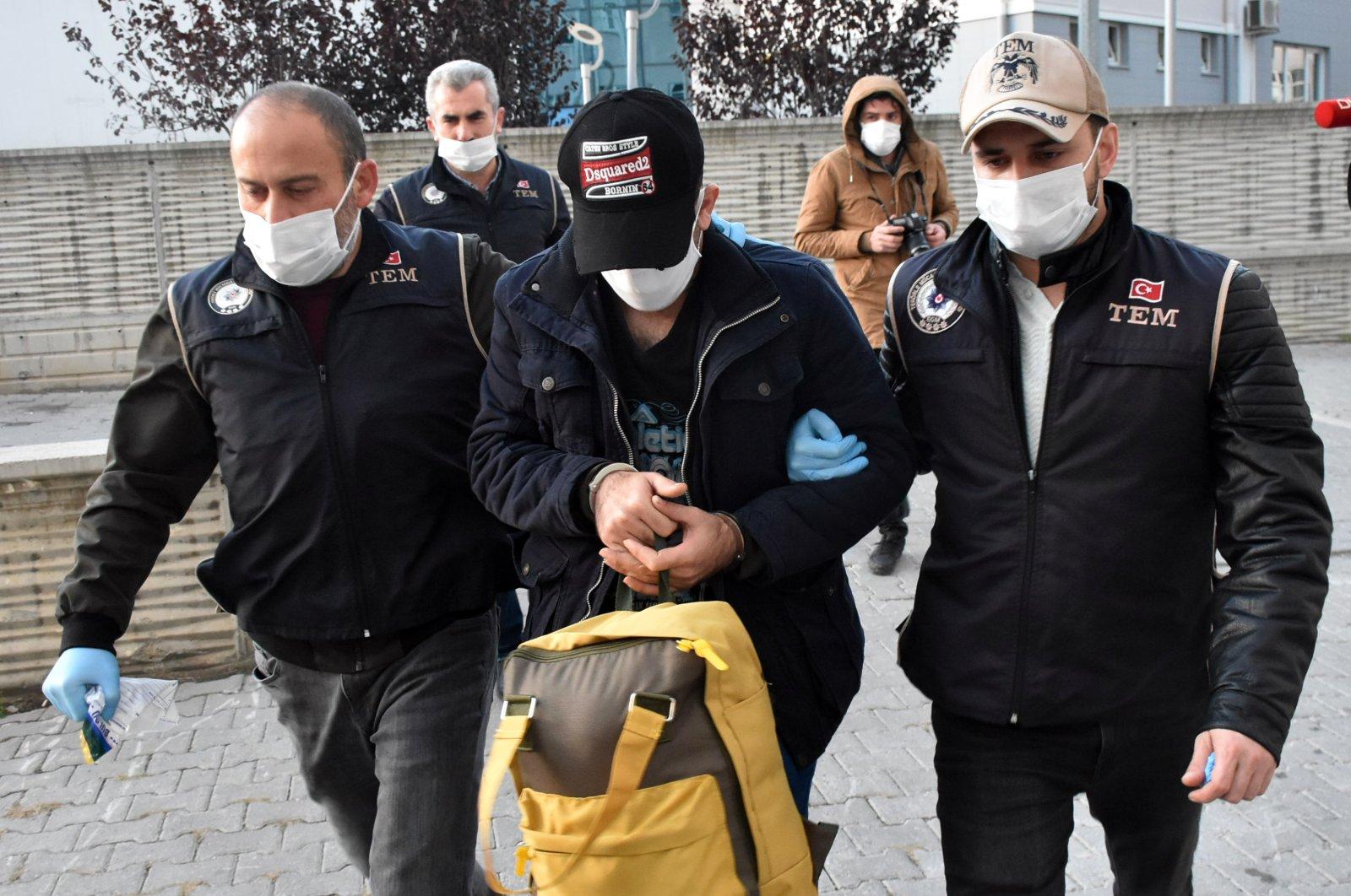 Police escort suspected Daesh terrorist to the police headquarters in Samsun, northern Turkey, Nov. 13, 2020 (AA Photo)