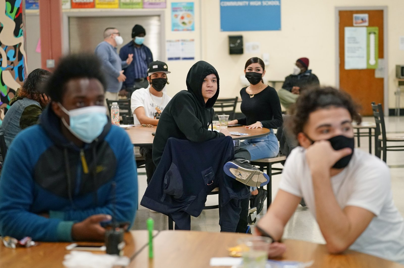 Students at West Brooklyn Community High School listen to questions posed by their principal during a current events trivia quiz and pizza party in the school's cafeteria in New York City, New York, U.S., Oct. 29, 2020. (AP Photo)
