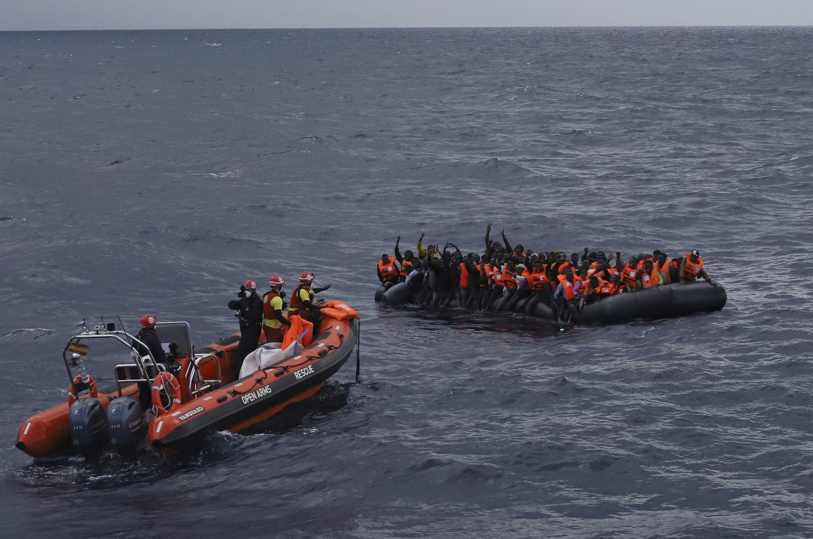 Refugees and migrants wait to be rescued by members of the Spanish NGO Proactiva Open Arms in the Mediterranean Sea, Nov. 11, 2020. (AP Photo)