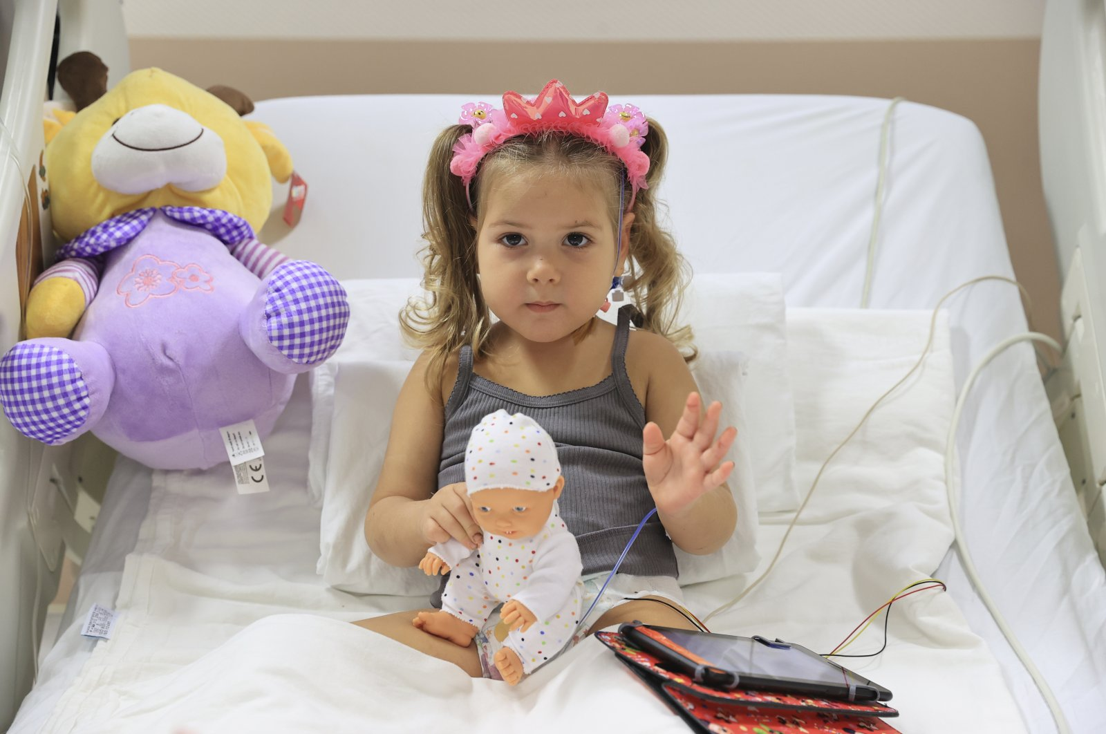 Three-year-old girl Ayda Gezgin sits in her bed in her hospital room after being rescued from the rubble following a 6.6 magnitude earthquake, in Izmir, Turkey, Nov. 5, 2020. (Turkey Health Ministry via AP)