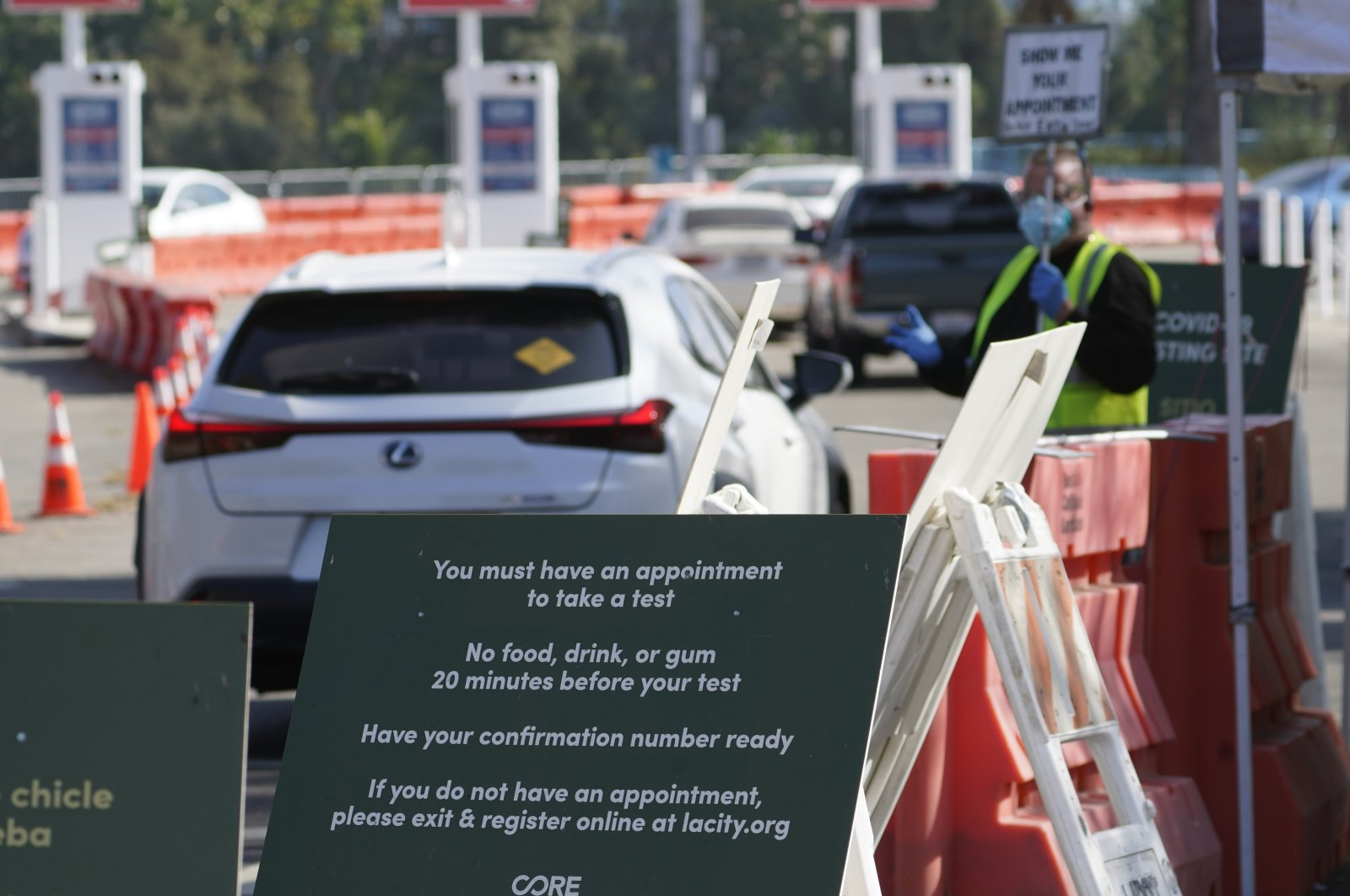 Drivers with an appointment wait in line to get a free COVID-19 self-test at Dodger Stadium, Los Angeles, California, U.S., Nov. 12, 2020. (AP Photo)