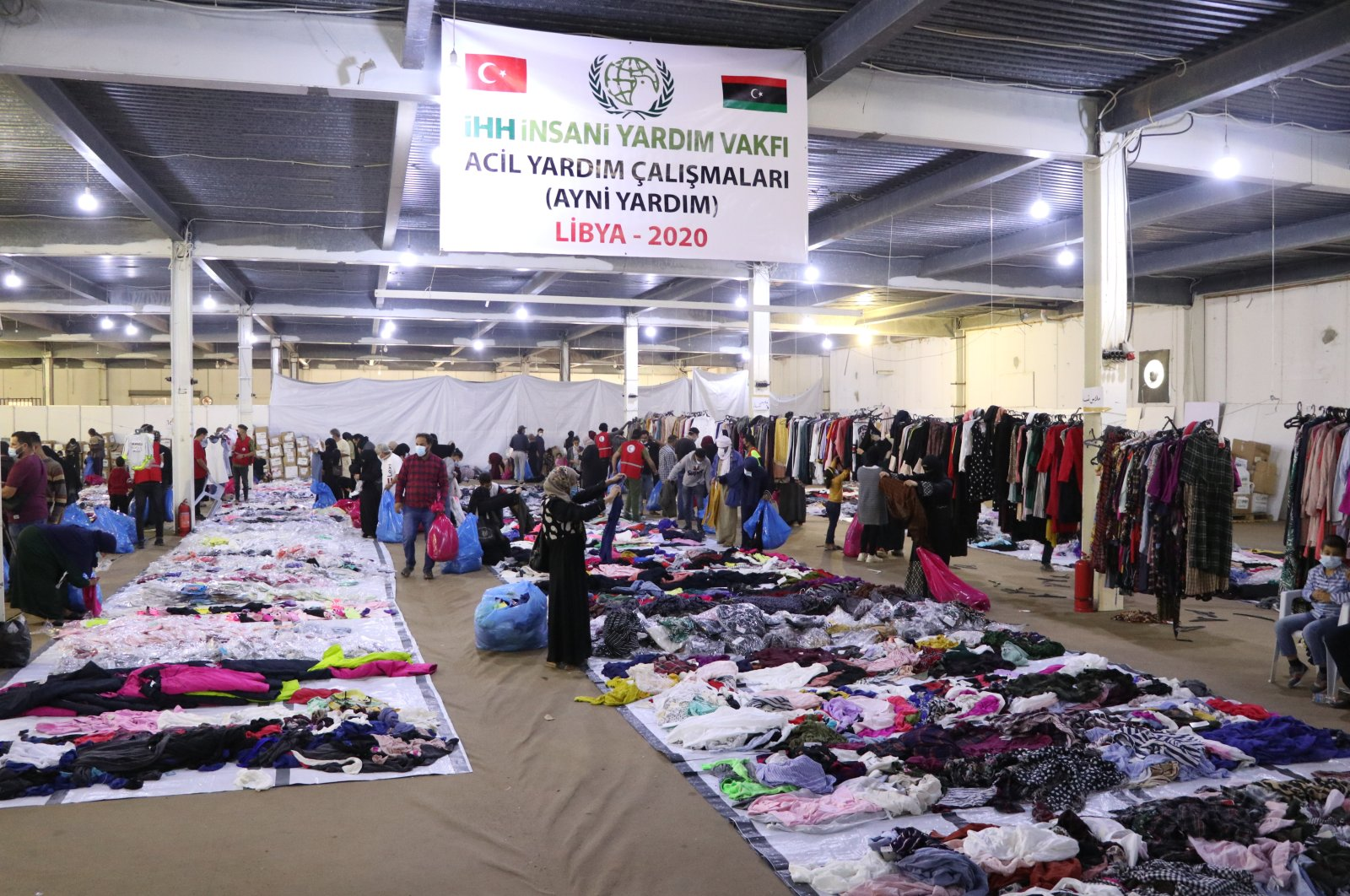 People look through clothing items at the IHH charity bazaar for displaced Libyans, Misrata, Libya, Nov. 13, 2020. (AA Photo)