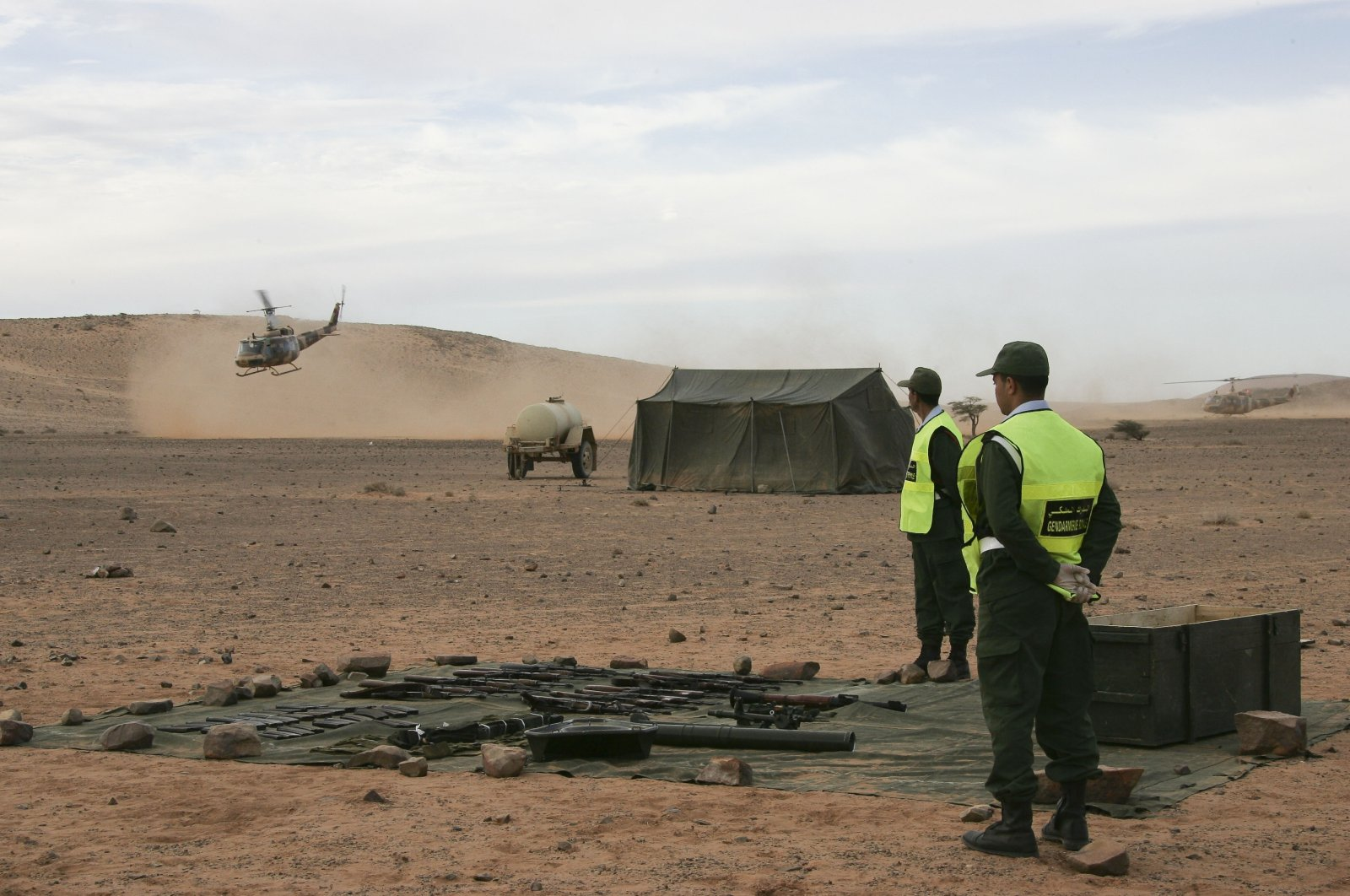 Weapons discovered by Moroccan police in Western Sahara are laid out, in Laayoune, Western Sahara, Jan. 5, 2011. (AP Photo)