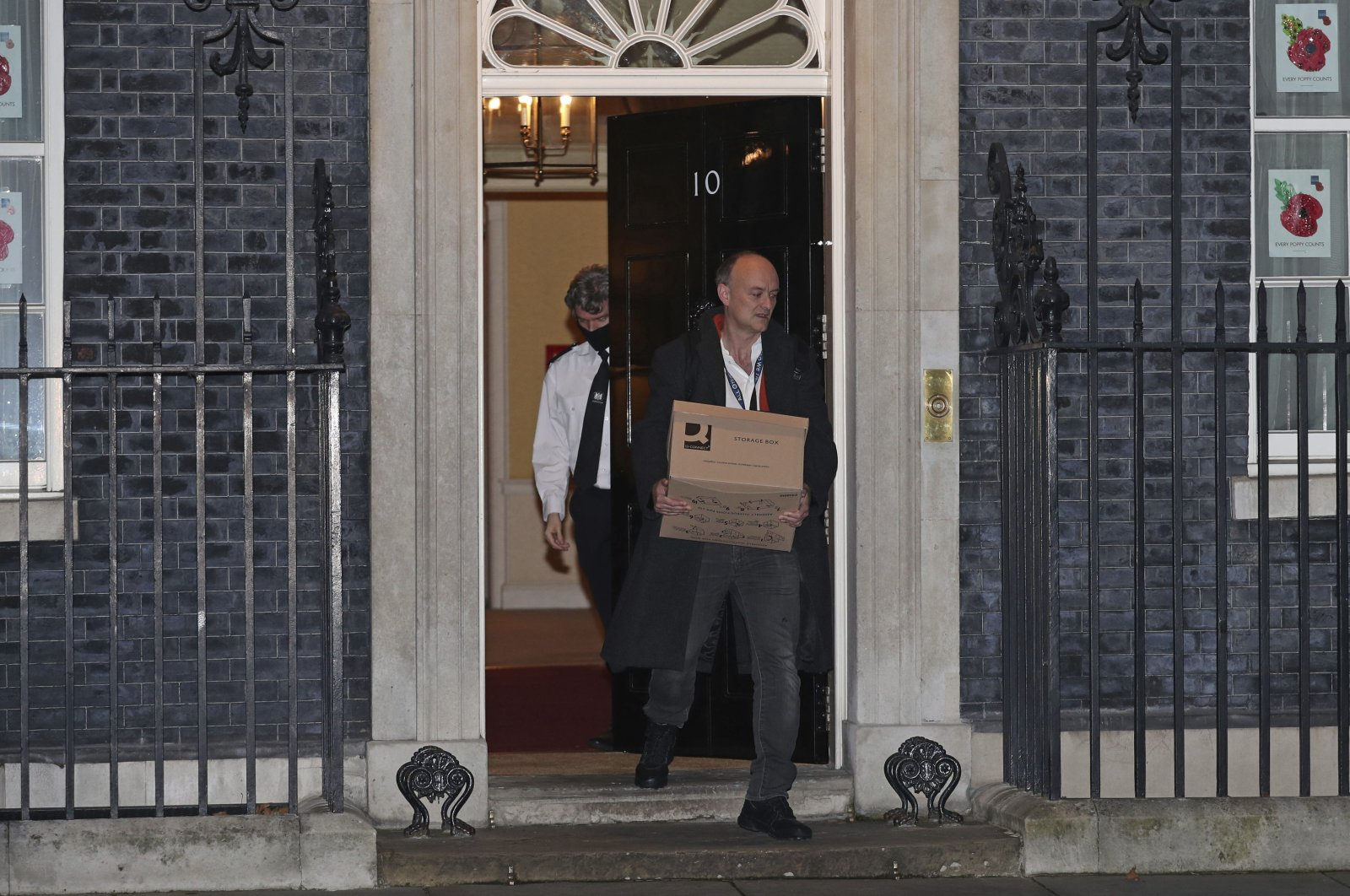 Britain's Prime Minister Boris Johnson's top aide Dominic Cummings leaves 10 Downing Street with a box, in London, Friday, Nov. 13, 2020. (AP Photo)