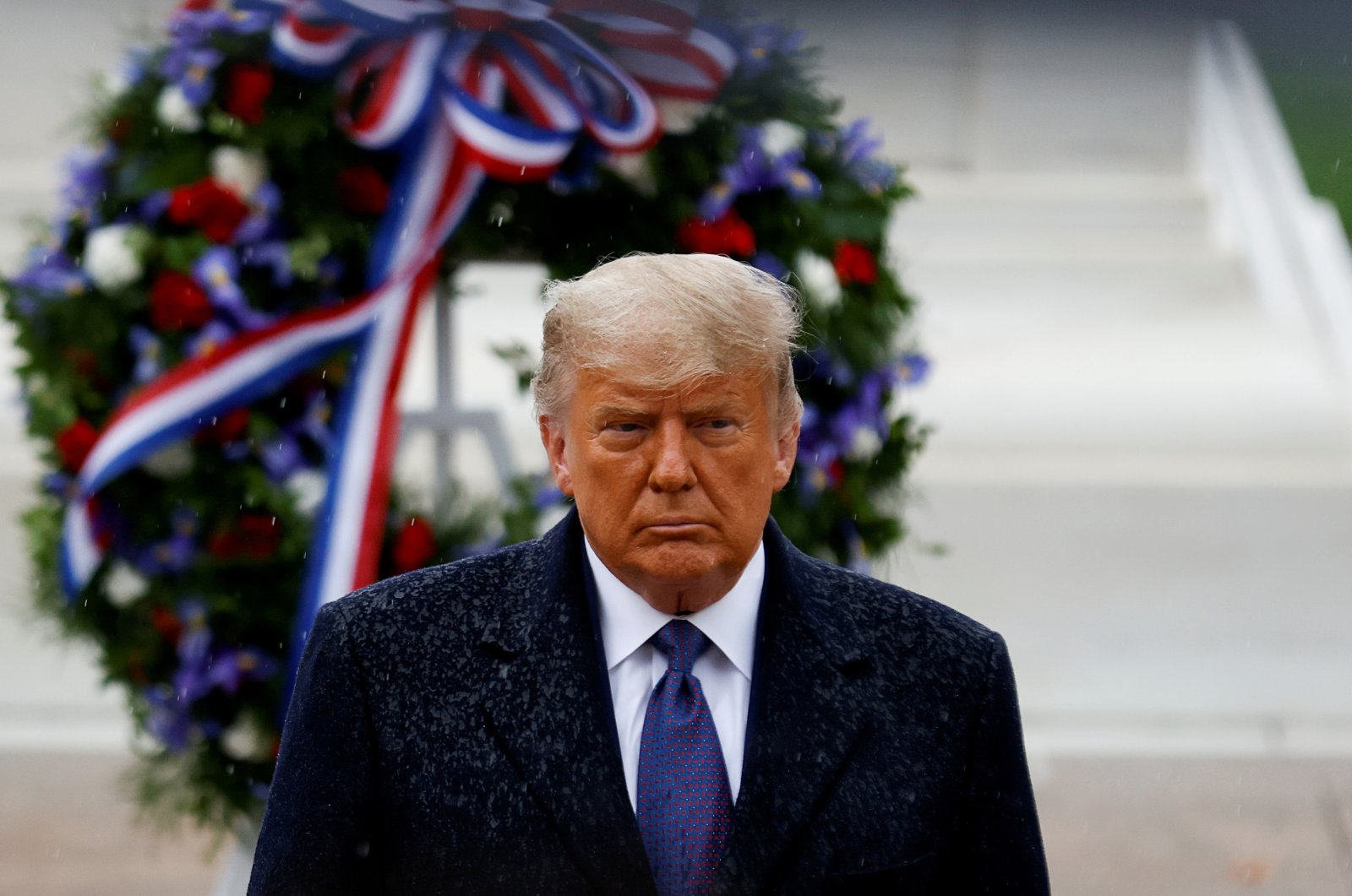 U.S. President Donald Trump turns after placing a wreath at the Tomb of the Unknown Soldier as he attends a Veterans Day observance in the rain at Arlington National Cemetery in Arlington, Virginia, U.S., Nov. 11, 2020. (Reuters Photo)