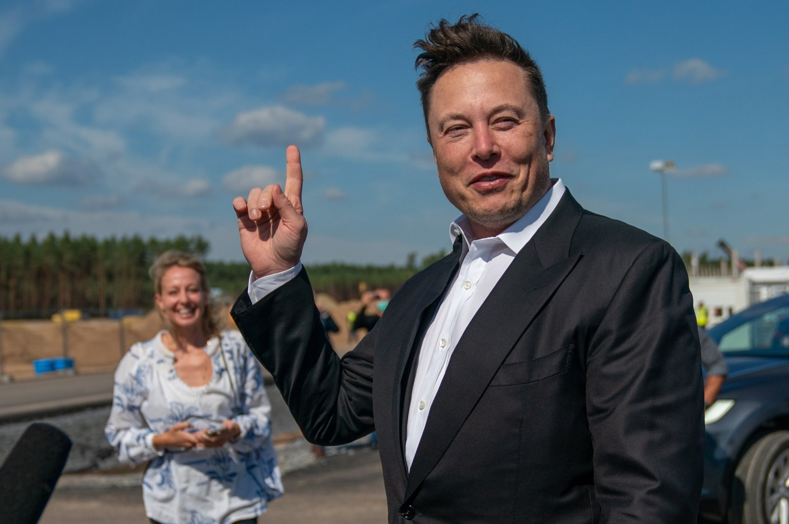 Tesla and SpaceX CEO Elon Musk (R) gives a statement at the construction site of the Tesla Giga Factory in Gruenheide near Berlin, Germany, Sept. 3, 2020. (EPA Photo)