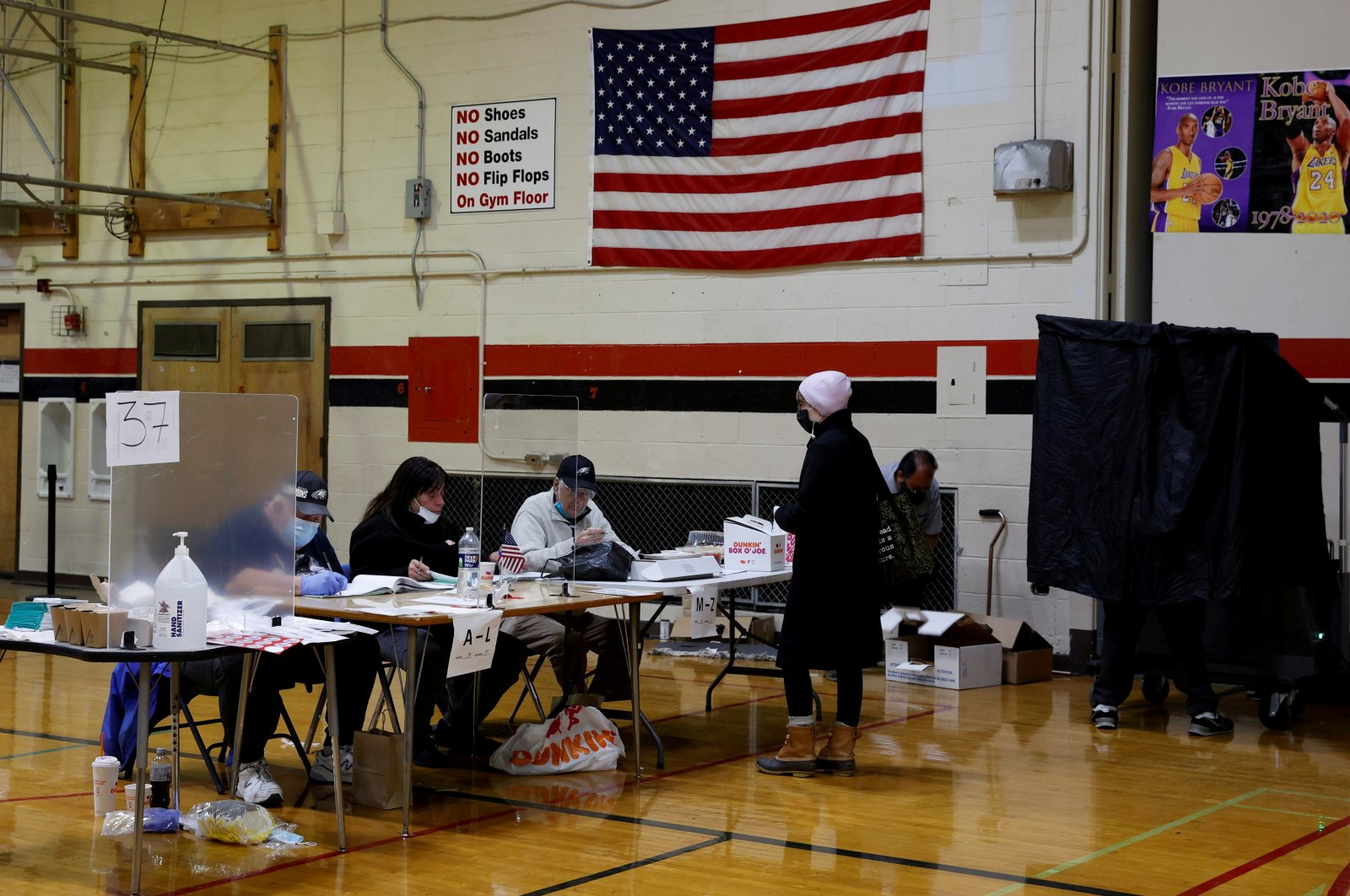 A voter and election workers wear protective masks on Election Day in South Philadelphia High School, in Philadelphia, Pennsylvania, U.S., Nov. 3, 2020. (Reuters Photo)