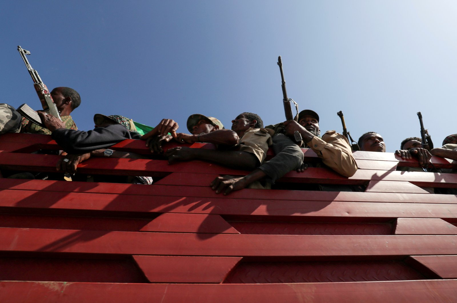 Members of Amhara region militias ride on their truck as they head to the mission to face the Tigray People's Liberation Front (TPLF), in Sanja, Amhara region near a border with Tigray, Ethiopia, Nov. 9, 2020. (Reuters Photo)