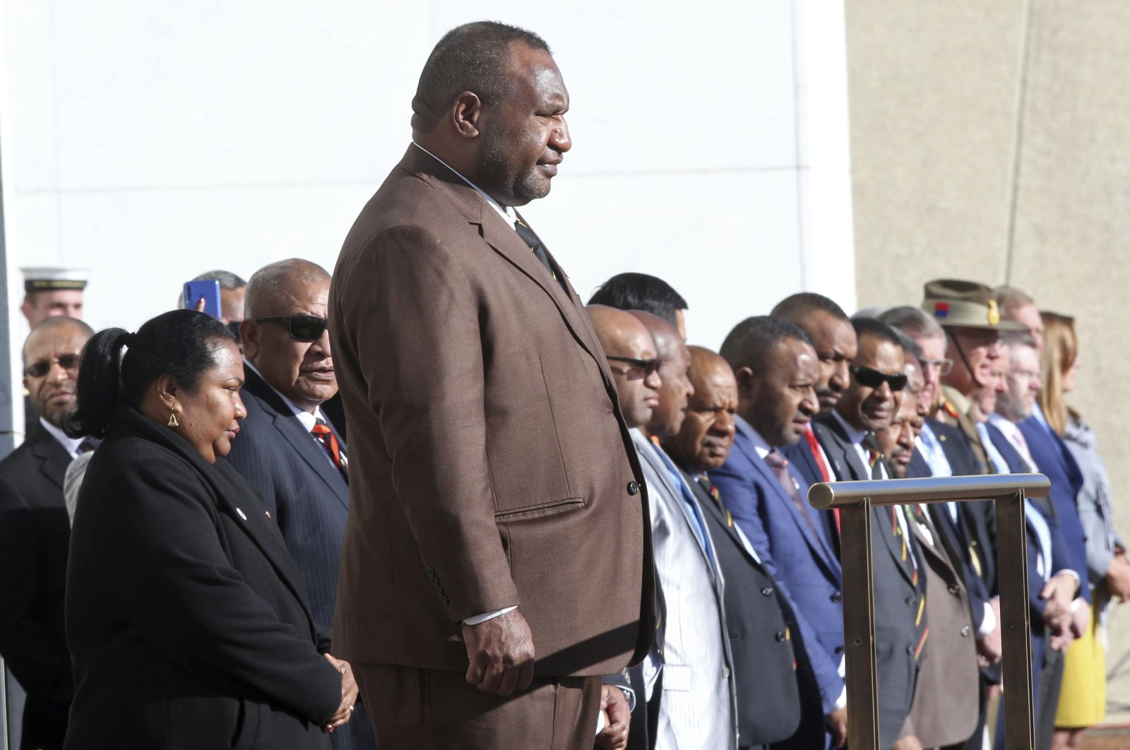 Papua New Guinea Prime Minister James Marape stands on a podium before inspecting troops as he is officially welcomed to Australia's Parliament House in Canberra, July 22, 2019. (AP Photo)