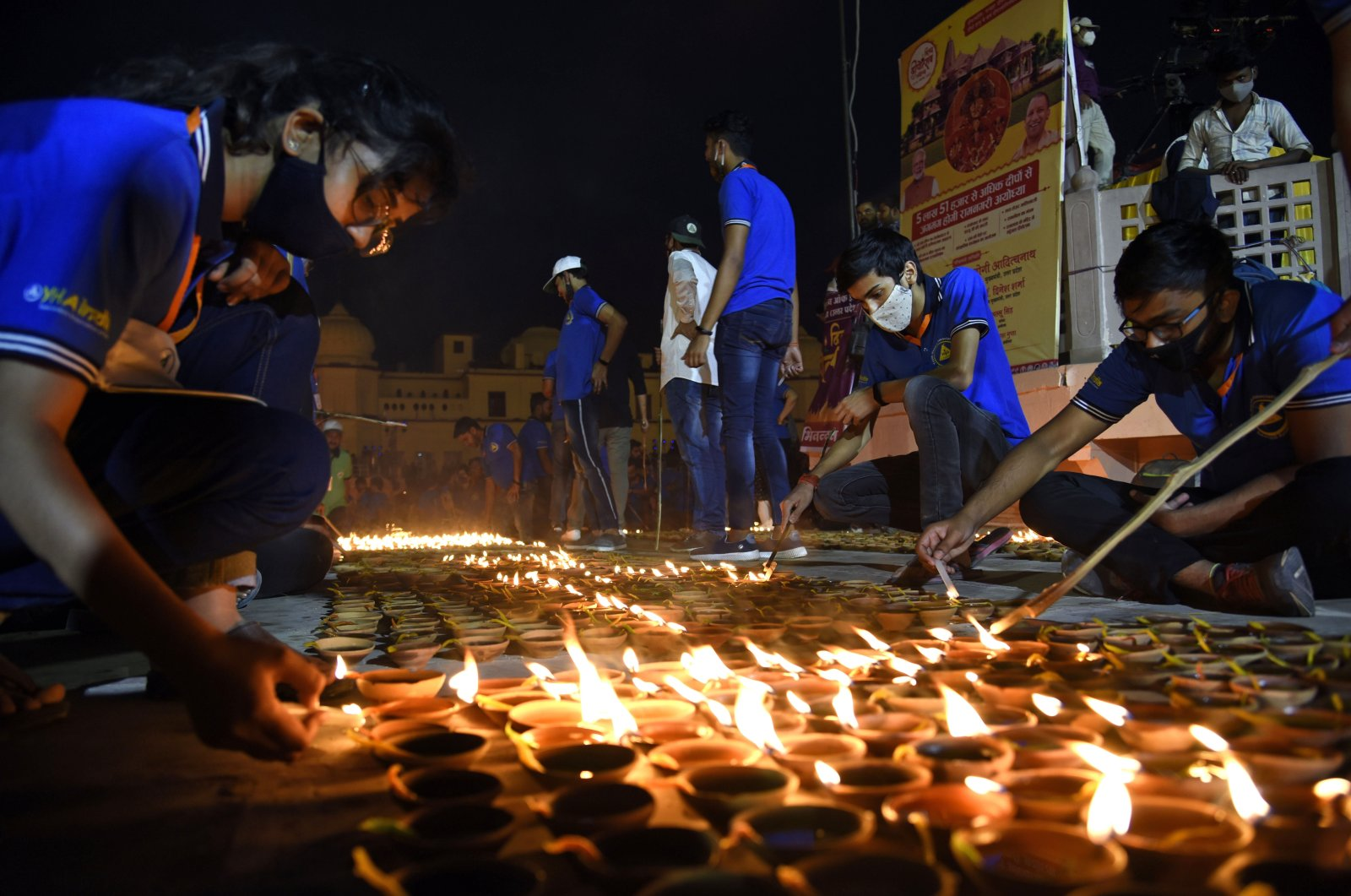 People light lamps on the banks of river Saryu in Ayodhya, India, Nov. 13, 2020. (AP Photo)