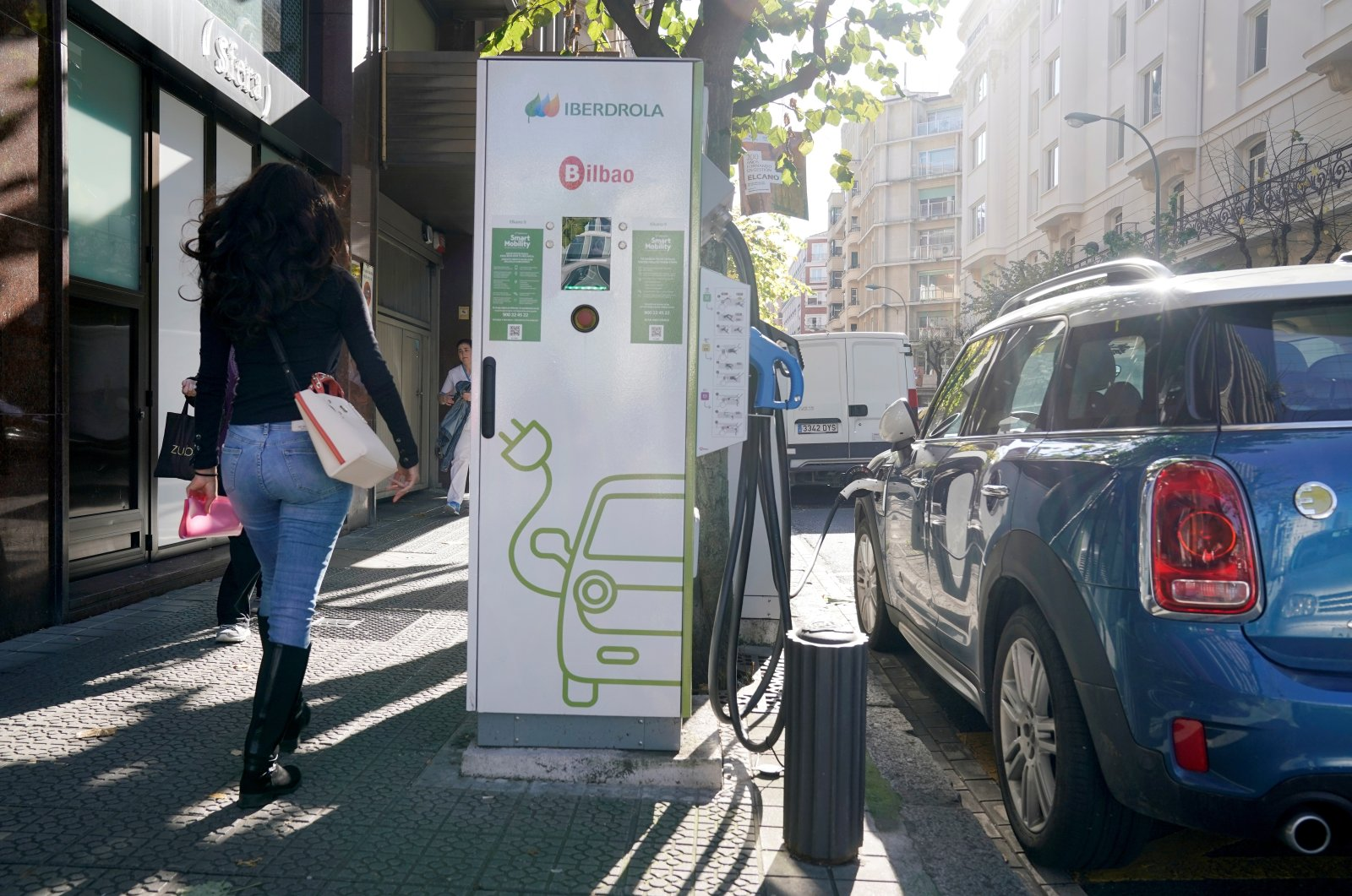 An electric car is charged from an Iberdrola electric car charging station in central Bilbao, Spain, Nov. 15, 2018. (Reuters Photo)