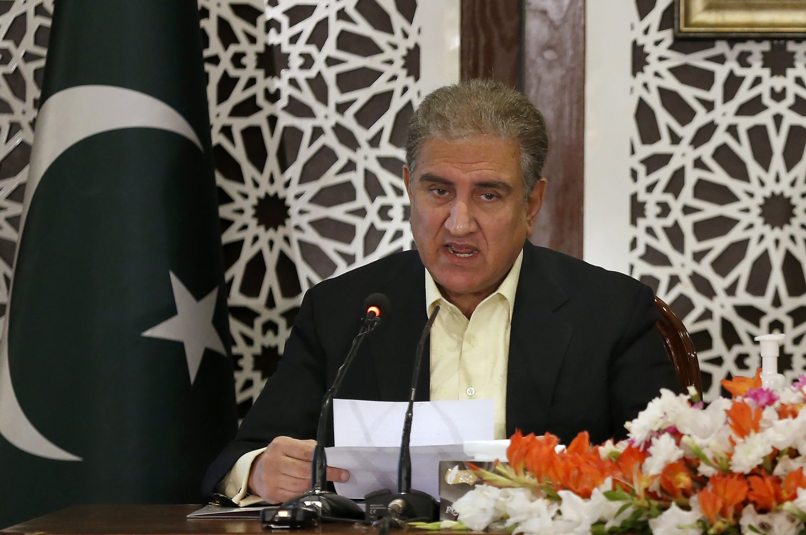 Pakistan's Foreign Minister Shah Mahmood Qureshi briefs the media during a joint press conference with military spokesperson regarding ongoing tension between Pakistan and India, in Islamabad, Pakistan, Nov. 14, 2020. (AP Photo)