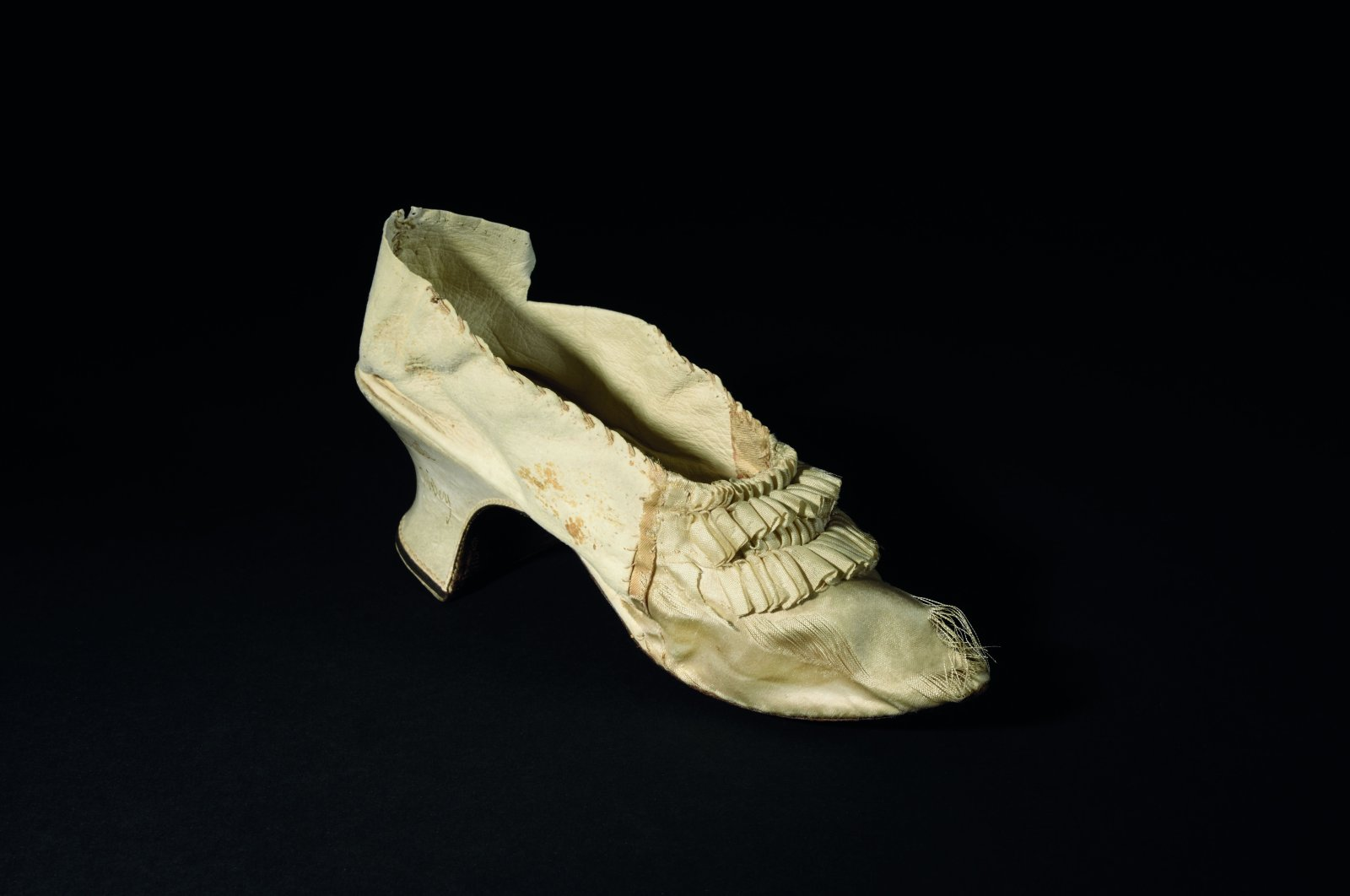 This handout photo taken by the auction house Osenat shows a white shoe that once belonged to Queen Marie-Antoinette, made of silk and goatskin, that will be auctioned on Nov. 15, 2020, in Versailles, on Oct. 5, 2020. (AP Photo)