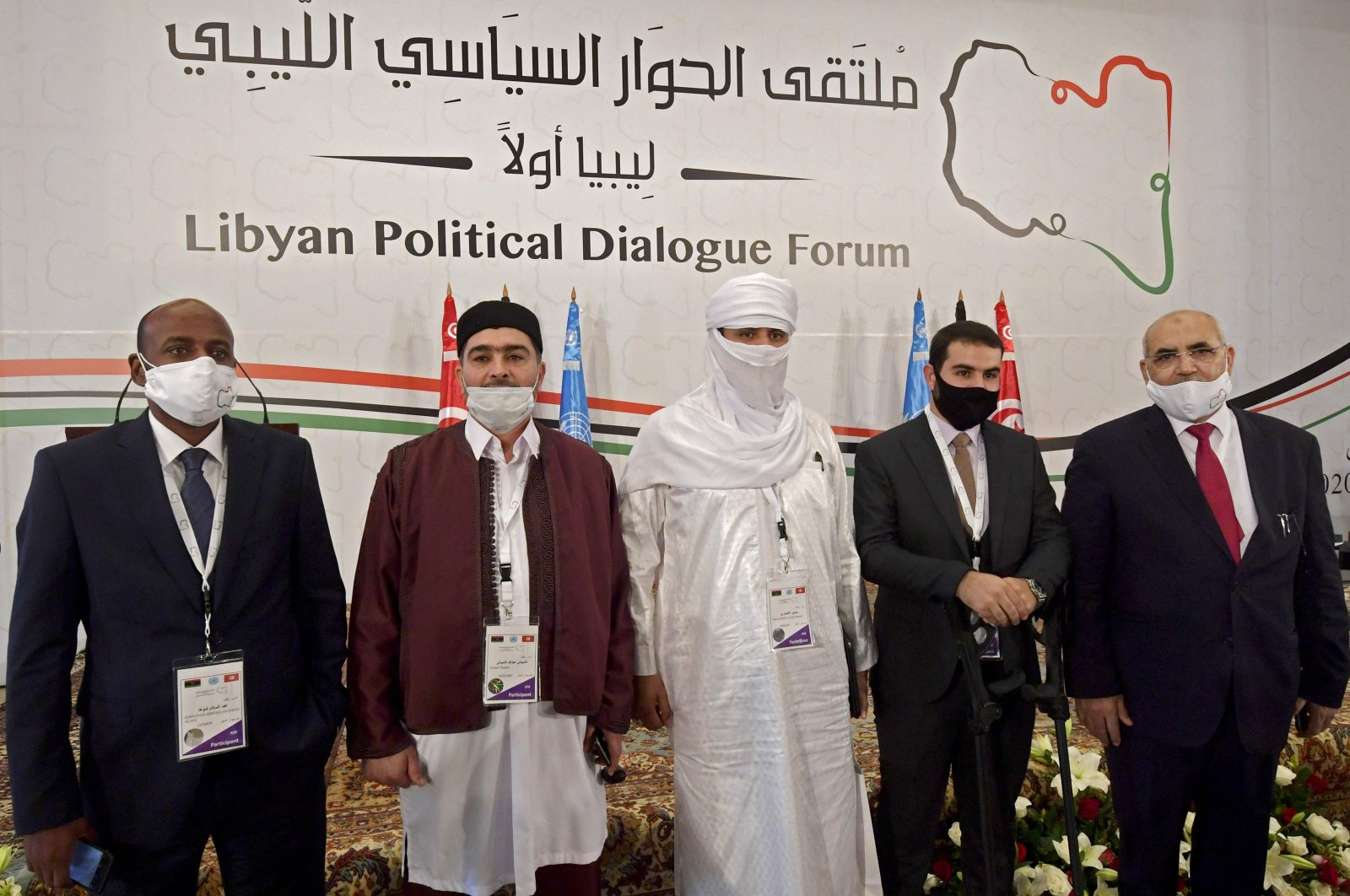 Libyan delegates, including (L-R) Abdessalam Shuha, Abdallah Shibani, Hussein Mohamed Elansari, an unidentified participant and Abdel Majid Mlayqtah attend the opening of the Libyan Political Dialogue Forum hosted in Gammarth on the outskirts of Tunisia's capital, on Nov. 9, 2020. (AFP Photo)