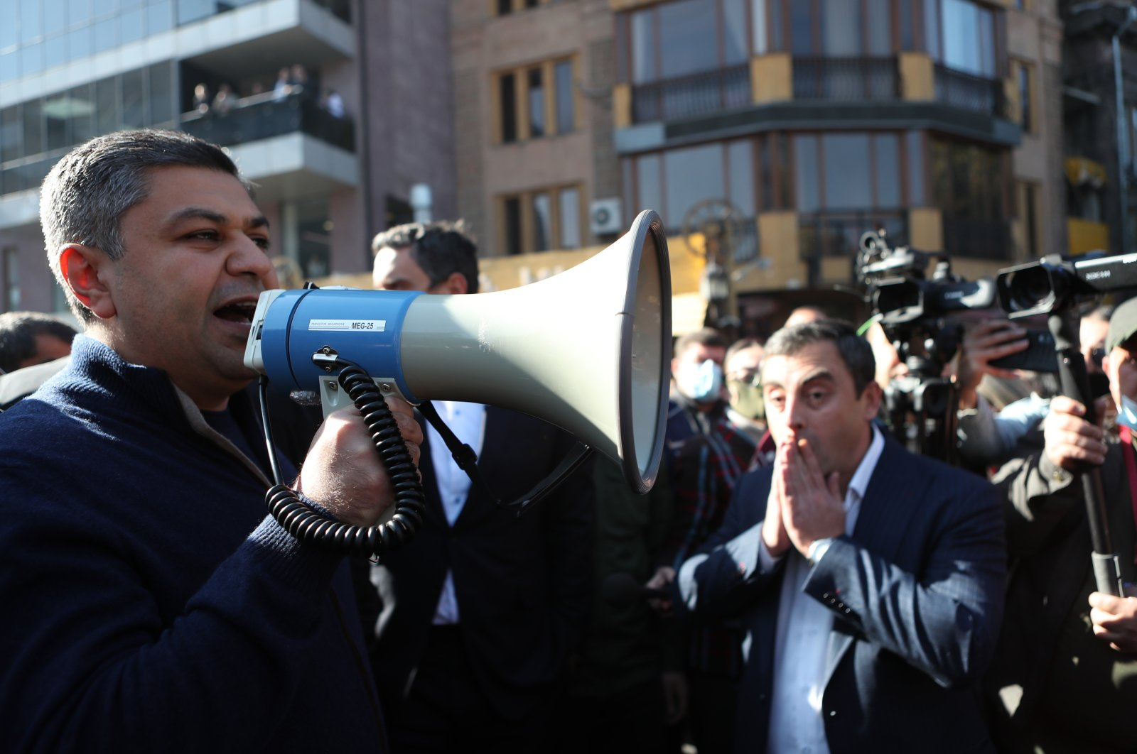 An Armenian opposition leader and former Director of Armenian National Security Service (NSS) Artur Vanetsyan (L) speaks during a rally in the Freedom Square in Yerevan, Armenia, Nov. 11, 2020. (EPA Photo)