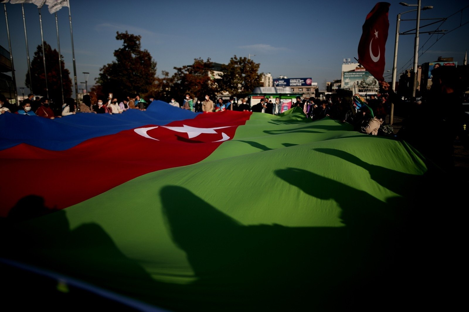 People wave an Azerbaijani flag during a celebration for Azerbaijan's victory against Armenia in the Nagorno-Karabakh region, Nov. 13, 2020. (İHA Photo)