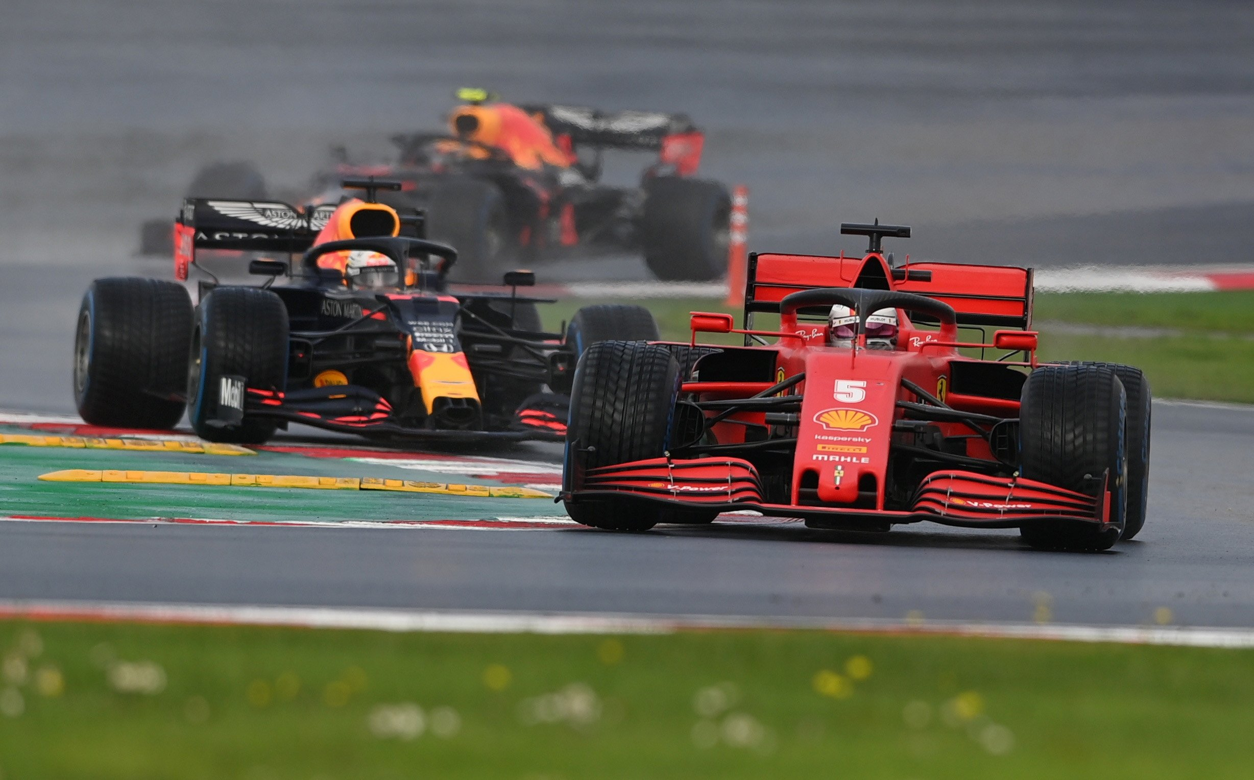Ferrari's Sebastian Vettel, front, and Red Bull's Max Verstappen in action during the Formula One Turkish Grand Prix in Istanbul, Turkey, Nov. 15, 2020. (Reuters Photo)