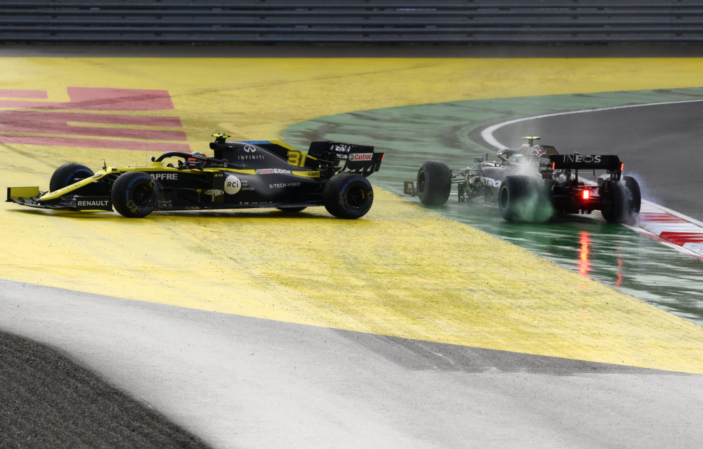 Renault driver Esteban Ocon, left, and Mercedes driver Valtteri Bottas spin off during the Formula One Turkish Grand Prix in Istanbul, Turkey, Nov. 15, 2020. (AP Photo)