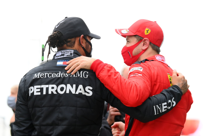 Ferrari driver Sebastian Vettel (R) congratulates Mercedes' Lewis Hamilton at the end of the Formula One Turkish Grand Prix in Istanbul, Turkey, Nov. 15, 2020. (AFP Photo)