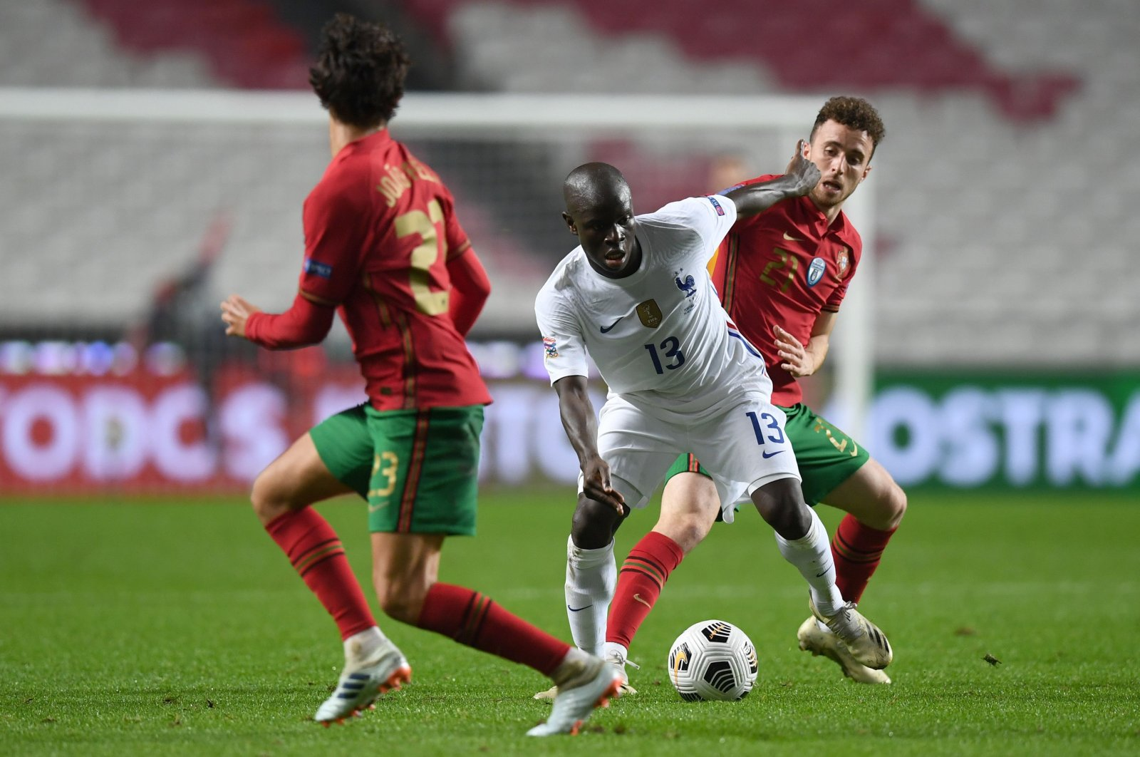 France's N'Golo Kante (C) vies with Portugal's Diogo Jota (R) during a UEFA Nations League match in Lisbon, Portugal, Nov. 14, 2020. (AFP Photo)