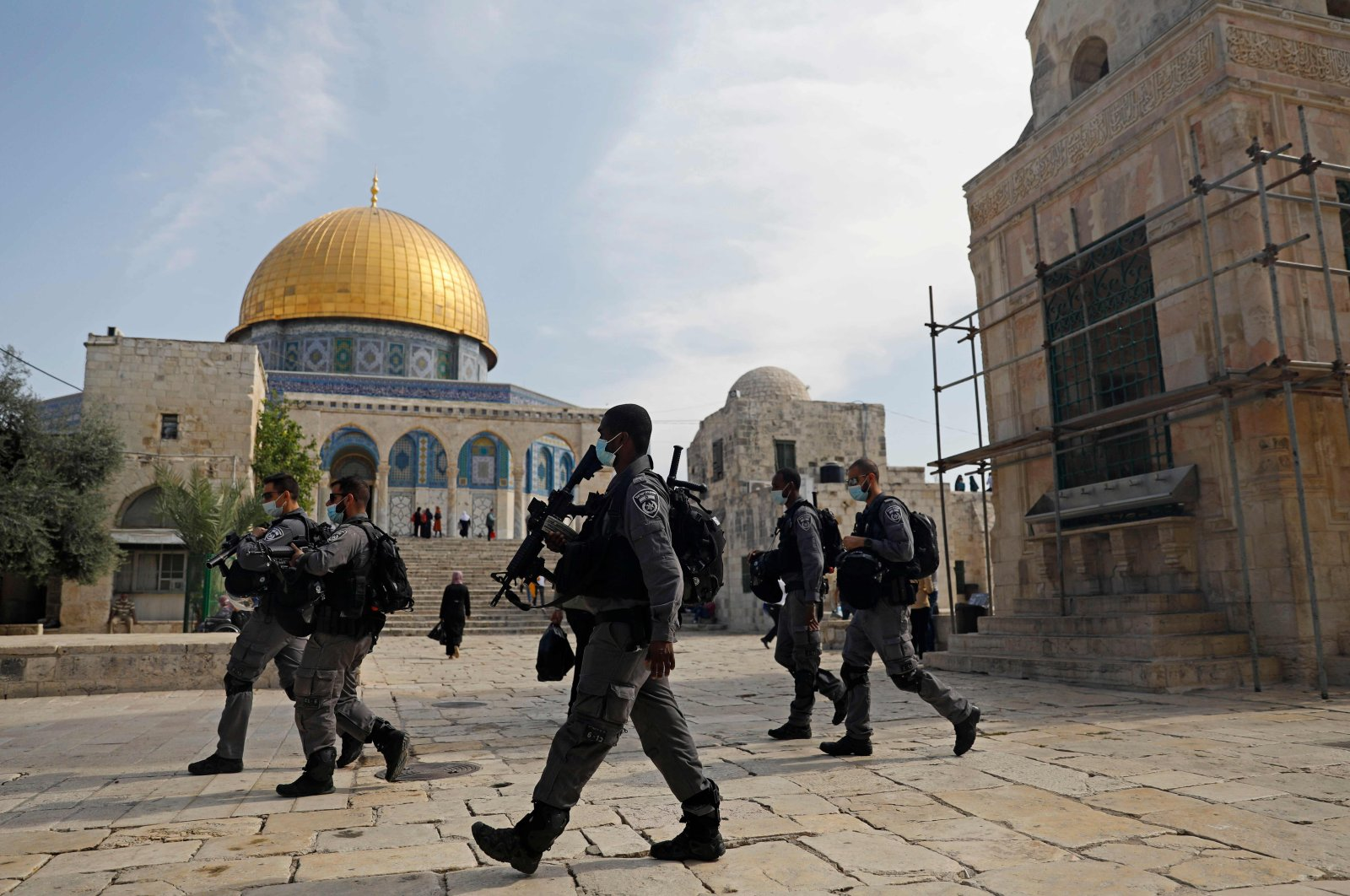 Israeli forces patrol the Al-Aqsa mosque compound, Islam's third holiest site, in the Old City of Jerusalem, as Palestinians stage protest (unseen) against comments by French President Emmanuel Macron defending cartoons of the Prophet Muhammed, Oct. 30, 2020. (AFP Photo)