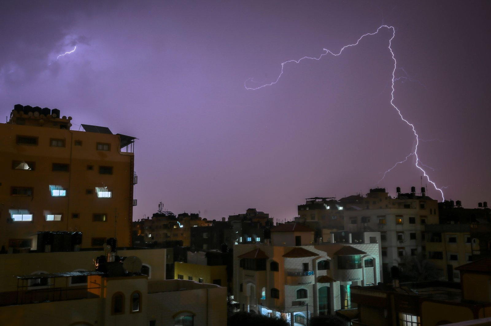 Lightning flashes over buildings during a thunderstorm in Gaza City, Nov. 15, 2020. (AFP File Photo)