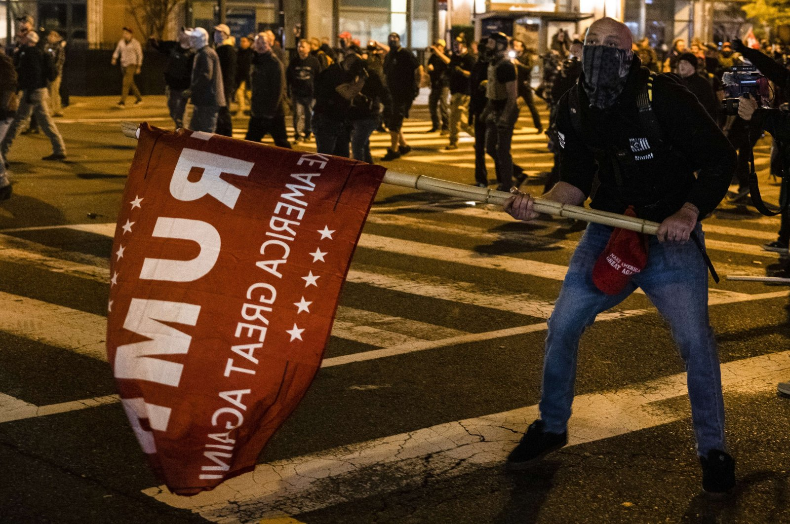 """Members of Antifa and Proud Boys clash in the middle of the street following the """"Million MAGA March"""" in Washington, DC, on Nov. 14, 2020. (AFP Photo)"""