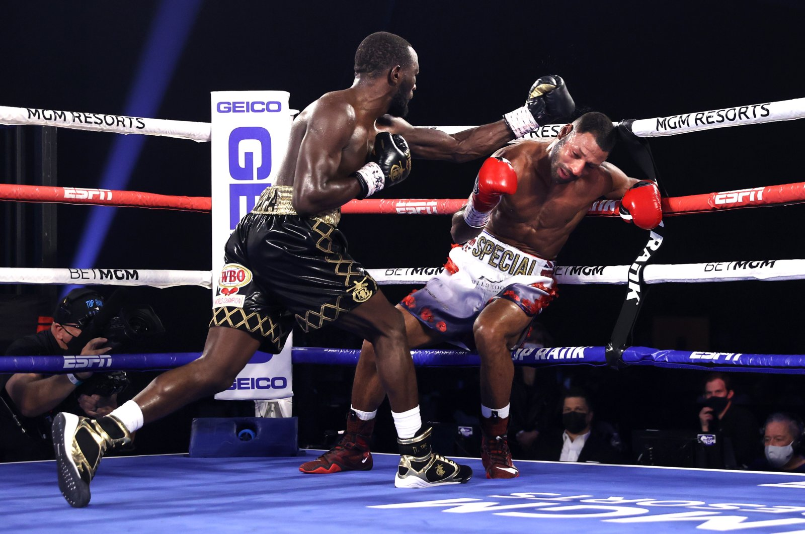 Terence Crawford and Kell Brook exchange punches during their World Boxing Organization welterweight bout in Las Vegas, U.S., Nov. 14, 2020. (Getty Images)