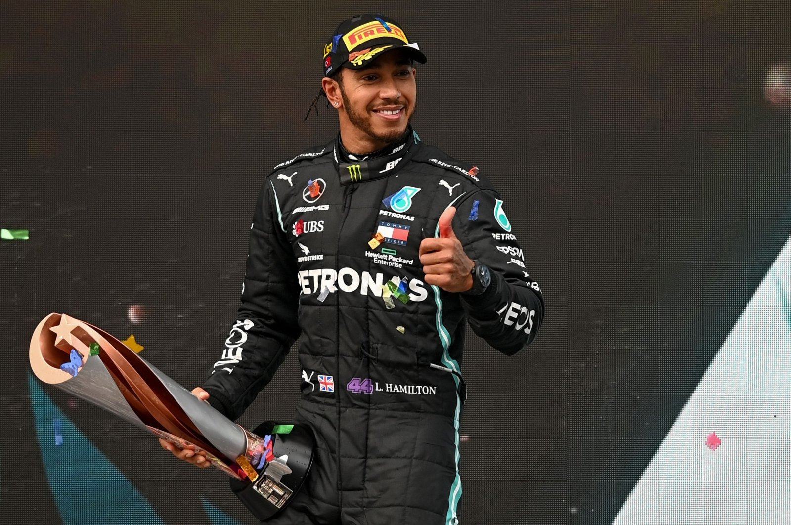 Mercedes driver Lewis Hamilton celebrates with his trophy after winning the Formula One Turkish Grand Prix in Istanbul, Turkey, Nov. 15, 2020. (AFP Photo)
