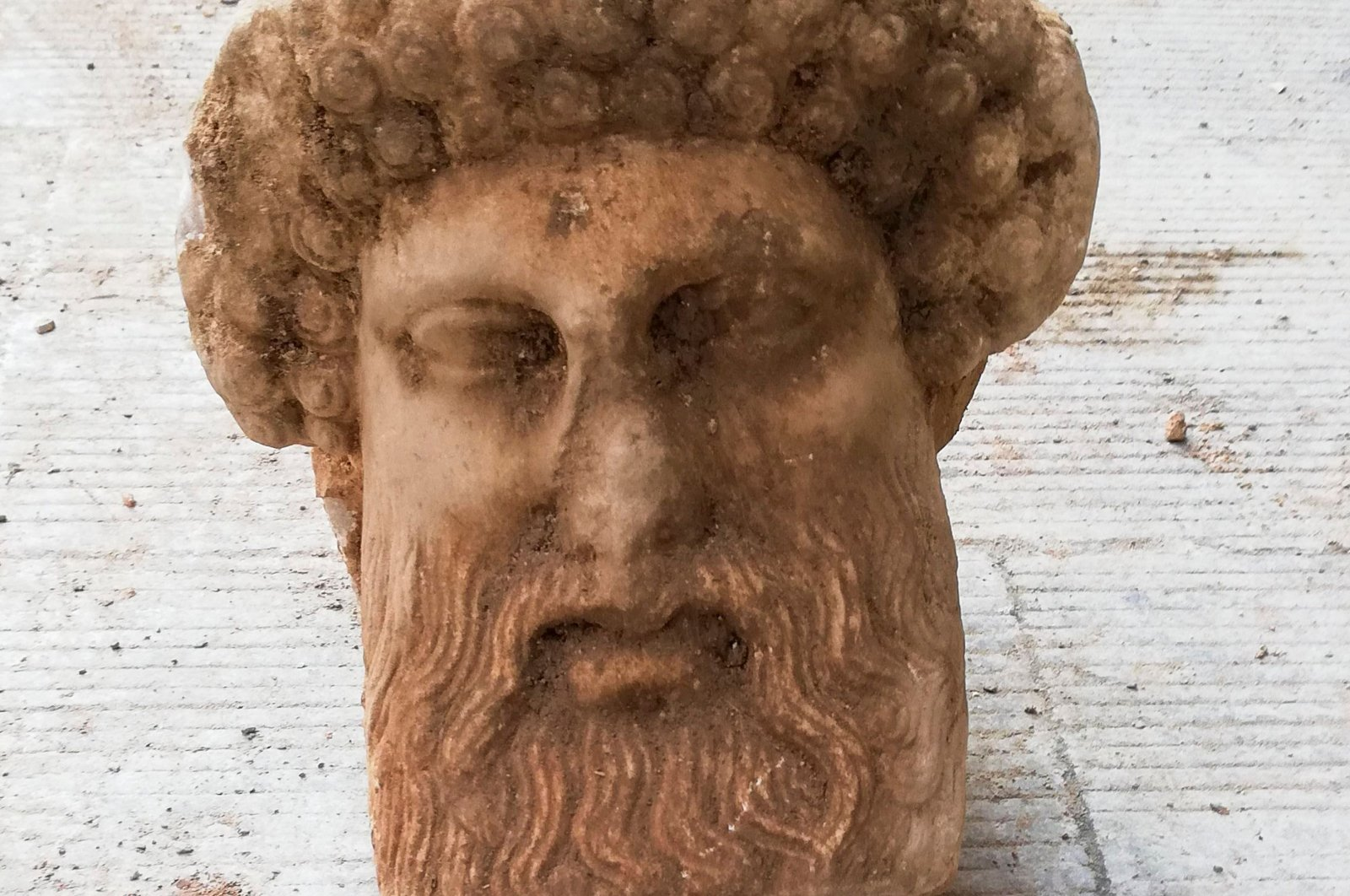 This handout picture released by the Greek Culture Ministry shows the head of an ancient statue of the Greek god Hermes which has been unearthed during excavations for sewage system improvements in central Athens, the ministry of culture said on Nov. 15, 2020. (Greek culture ministry Photo via AFP)