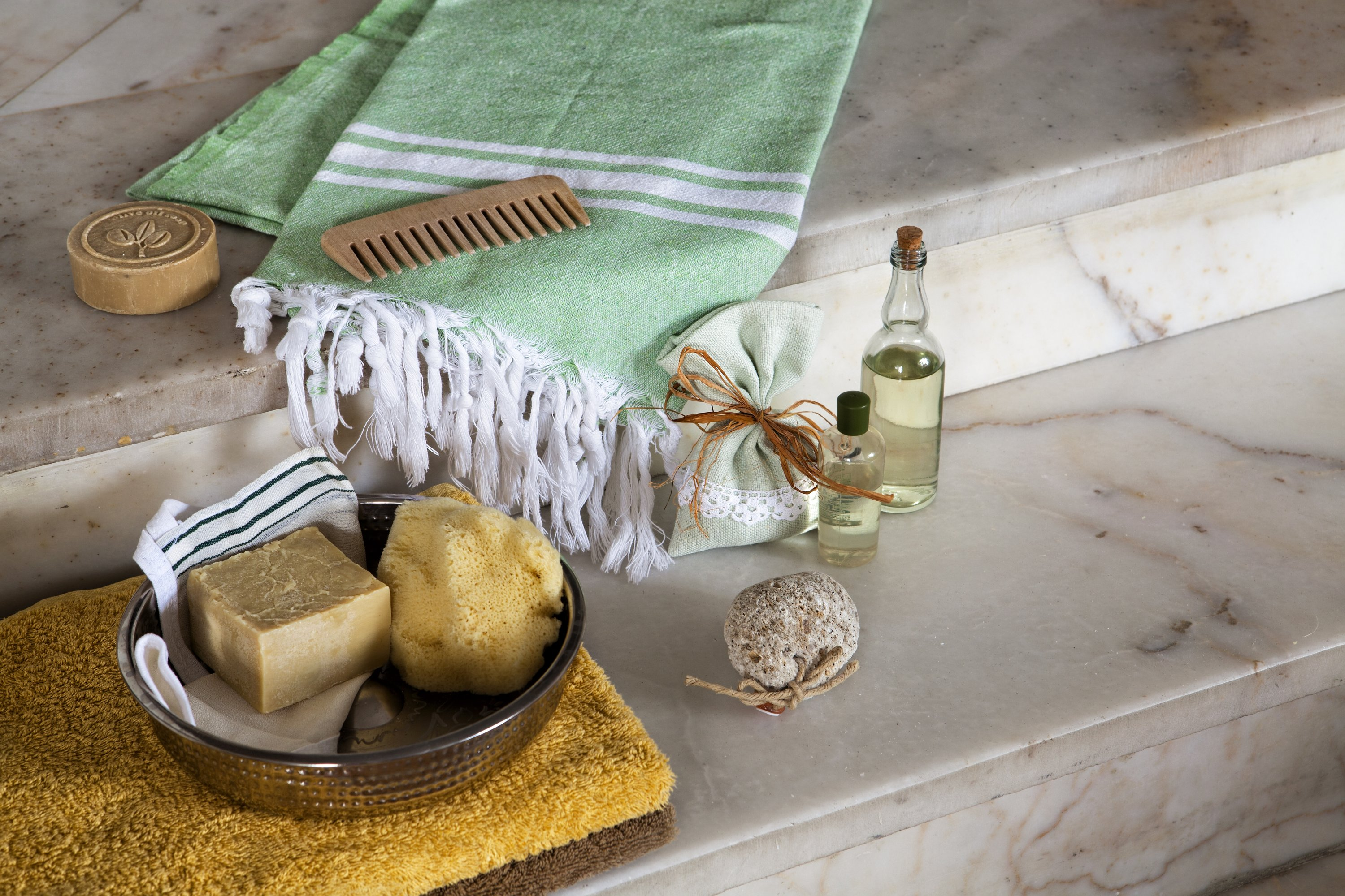 A peştamal, a bar of soap and a kese to scrub with are essential for a Turkish bath. (Shutterstock Photo)