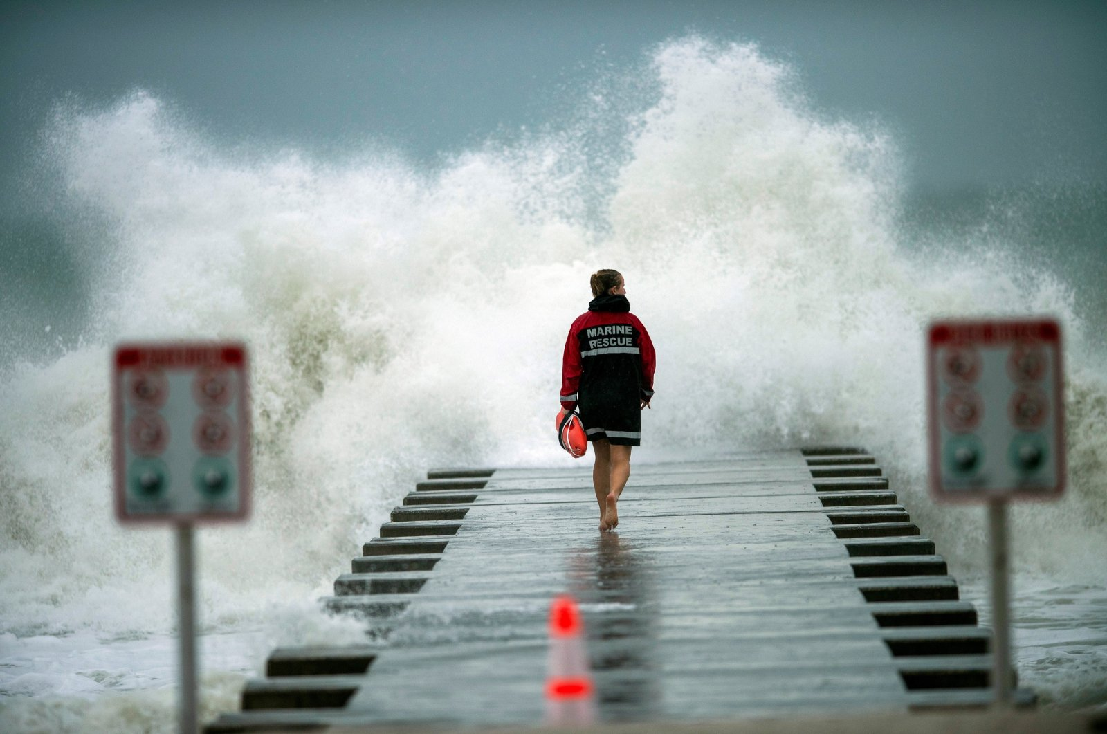 A lifeguard walks to the end of the jetty after closing it down to surfers before the arrival of Tropical Storm Eta in Bradenton Beach, Florida, U.S., Nov. 11, 2020. (Reuters Photo)