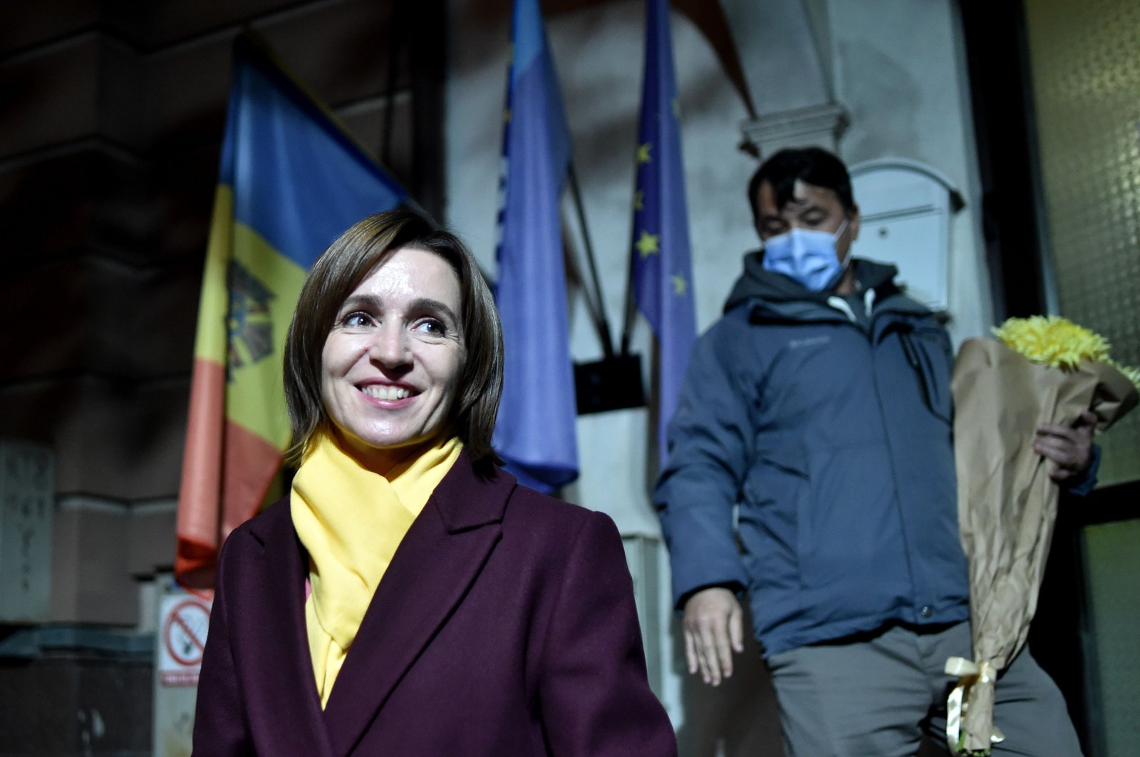 Moldovan presidential candidate Maia Sandu smiles as she leaves the Action and Solidarity Party office following her victory in the second round of the country's presidential election, Chisinau, Moldova, Nov. 16, 2020. (AFP Photo)