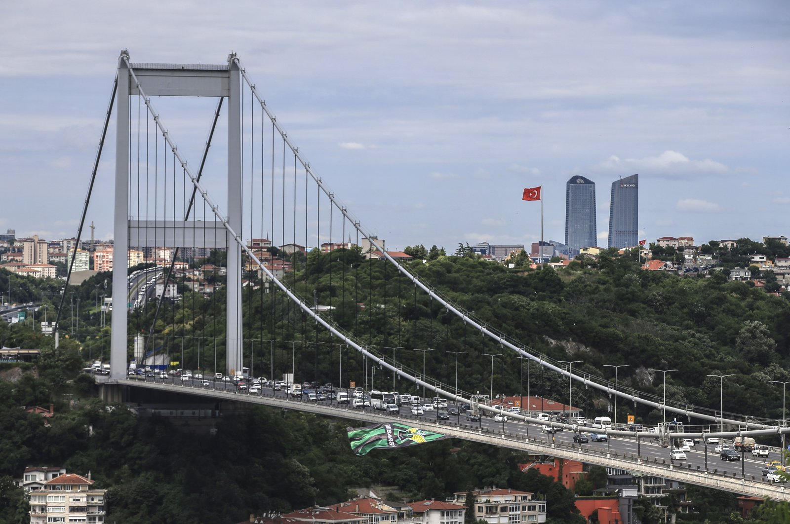 Traffic crosses the Fatih Sultan Mehmet Bridge over the Bosporus Strait, separating Asia and Europe in Istanbul, Turkey, June 25, 2018. (AP Photo)
