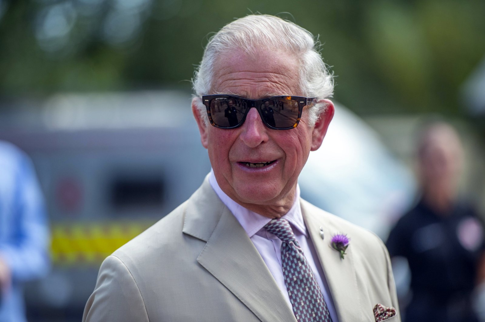 Britain's Prince Charles speaks to emergency workers during a visit to Middlemoor Fire Station, where he met Emergency Service Personnel from the local Fire Department, Police and Ambulance services, in Devon, England, July 22, 2020. (Pool photo via AP)