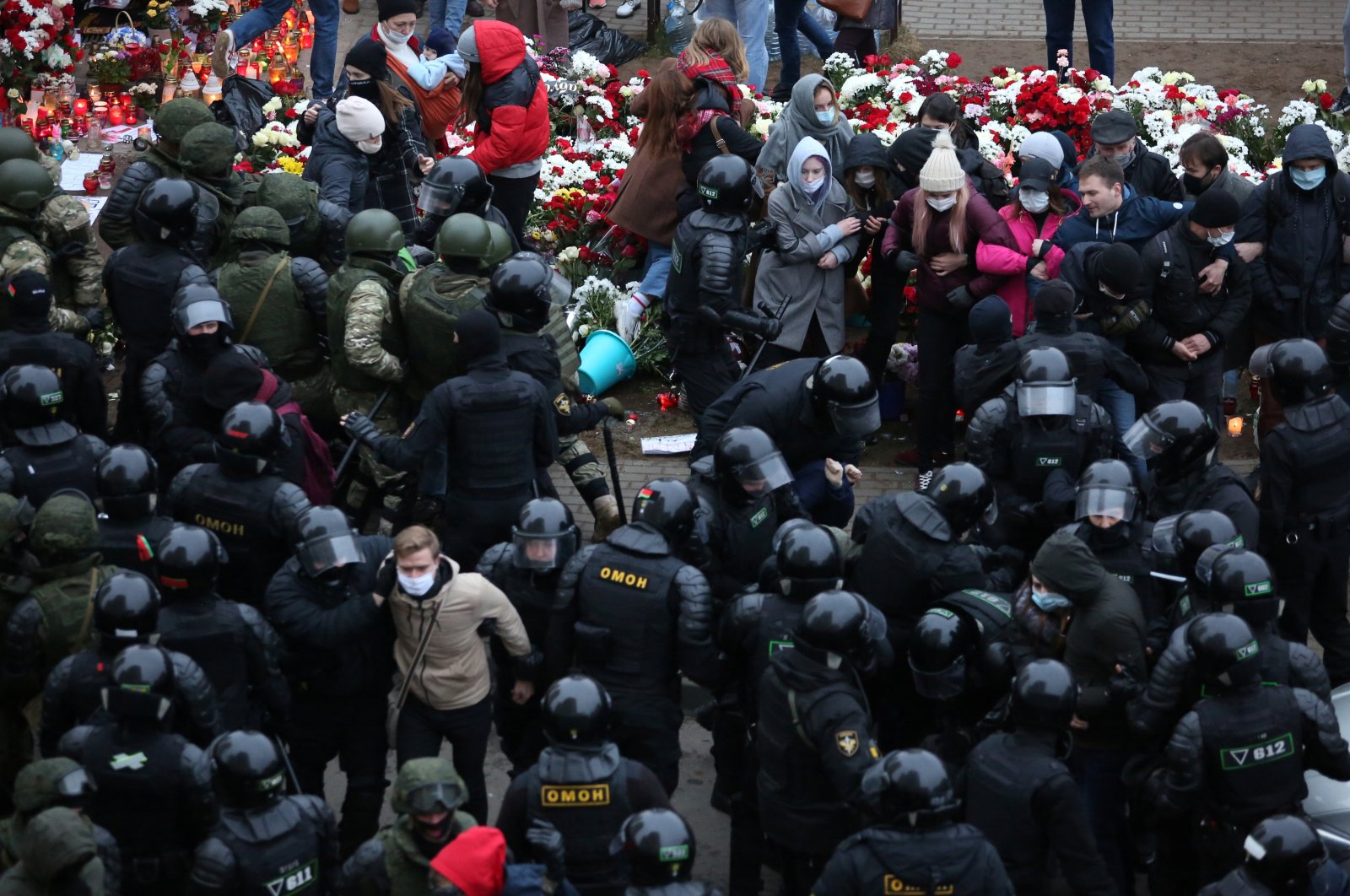 Belarusian law enforcement officers surround demonstrators during a rally to reject the presidential election results in Minsk, Belarus, Nov. 15, 2020. REUTERS/Stringer