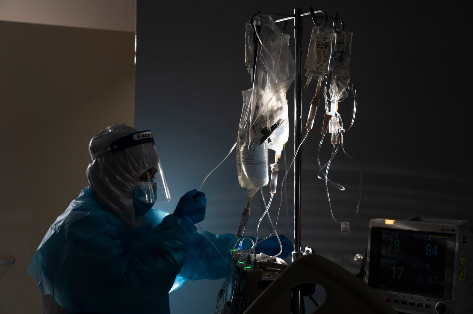 A medical staff member treats a patient suffering from the coronavirus disease in the COVID-19 intensive care unit (ICU) at the United Memorial Medical Center, Houston, Texas, Nov. 14, 2020. (Getty Images)
