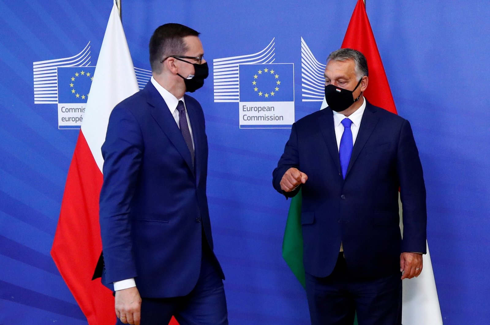 Poland's Prime Minister Mateusz Morawiecki and Hungary's Prime Minister Viktor Orban arrive ahead of a meeting with European Commission President Ursula von der Leyen in Brussels, Belgium, Sept. 24, 2020. (Reuters Photo)