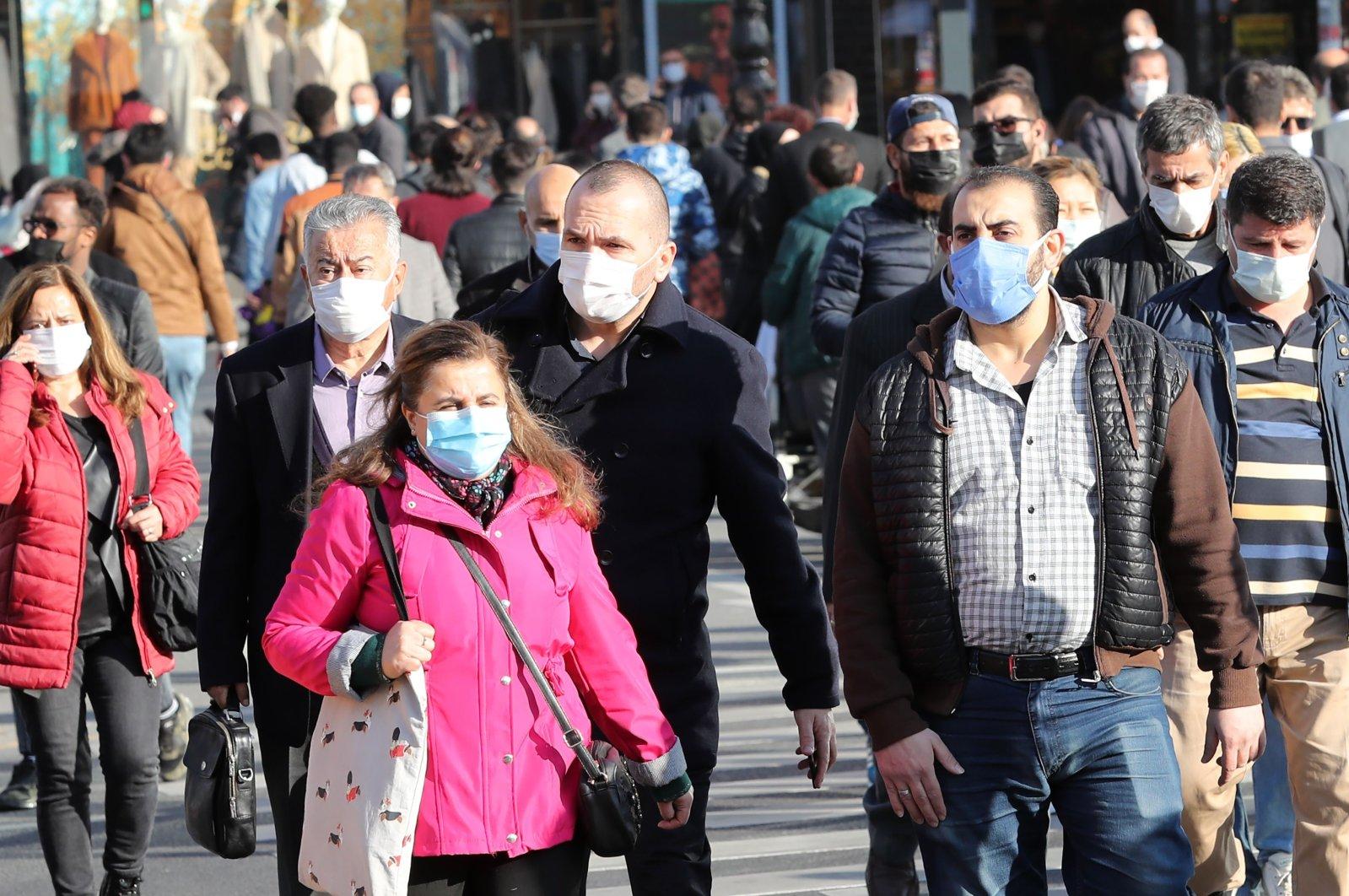 Pedestrians wearing face masks walk in the capital Ankara, Turkey, Nov. 13, 2020. (AFP Photo)