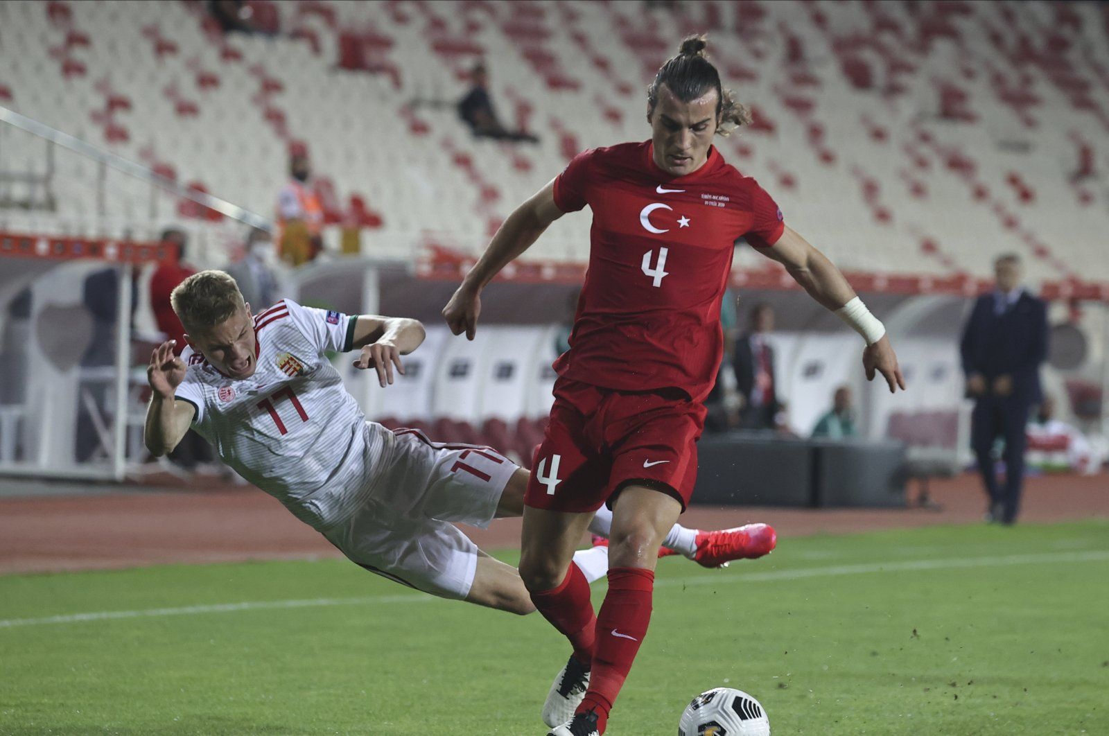 Hungary's Andras Schafer (L) reacts as he tries to stop Turkey's Çağlar Söyüncü during a UEFA Nations League match in Sivas, Turkey, Sept. 3, 2020. (AP Photo)
