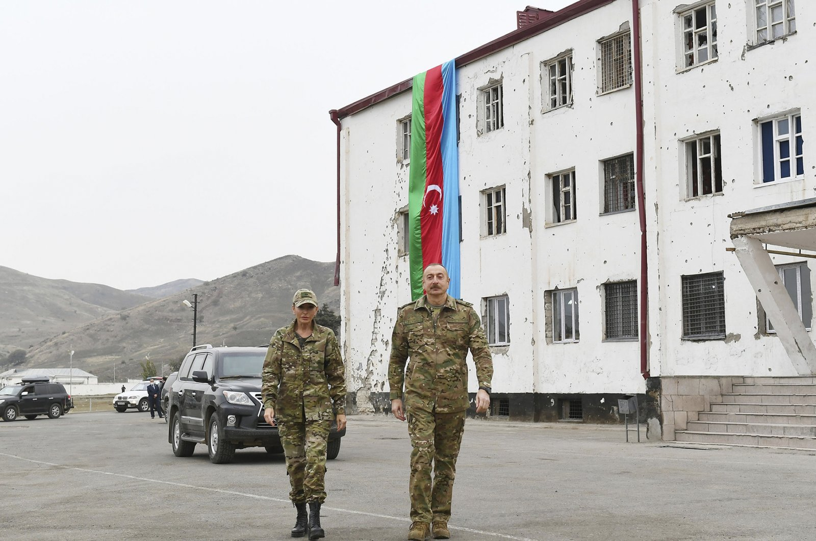 This handout photo provided by Azerbaijan's Presidential Press Office, shows President Ilham Aliyev and his wife and Vice President Mehriban Aliyeva visiting the liberated Fuzuli and Jabrayil districts of Azerbaijan, Nov. 16, 2020. (Azerbaijani Presidential Press Office via AP)