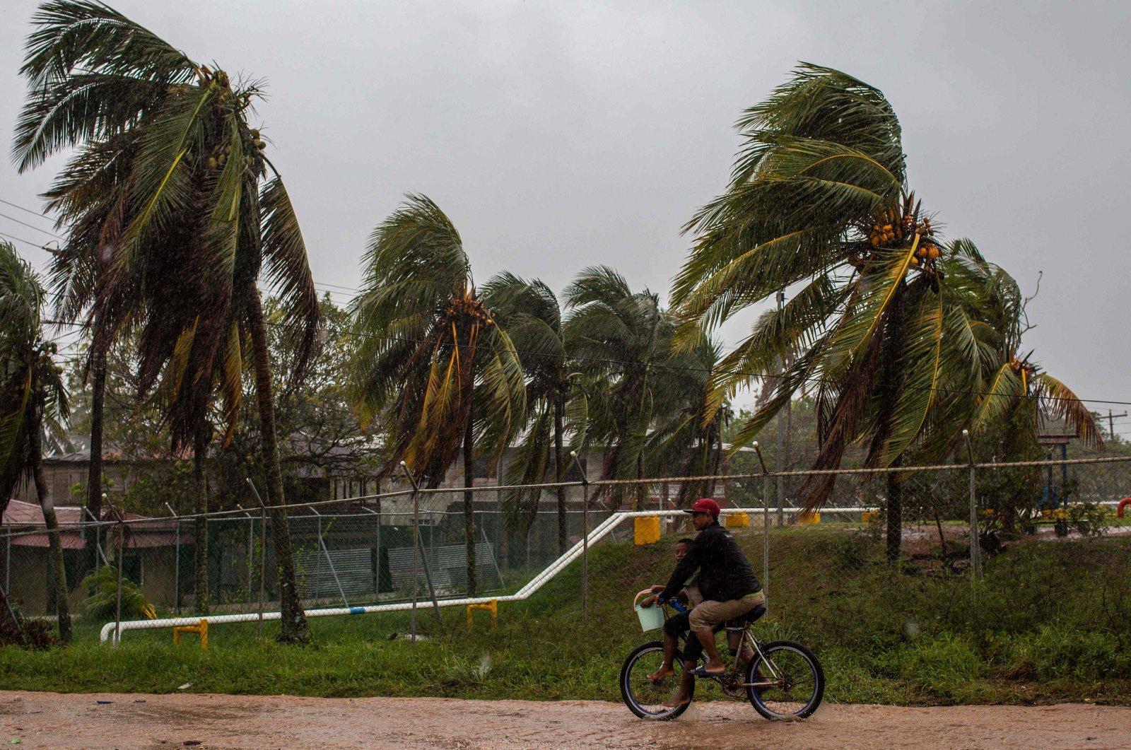 A man rides his bicycle in Bilwi, Puerto Cabezas, Nicaragua on Nov. 16, 2020. (AFP Photo)
